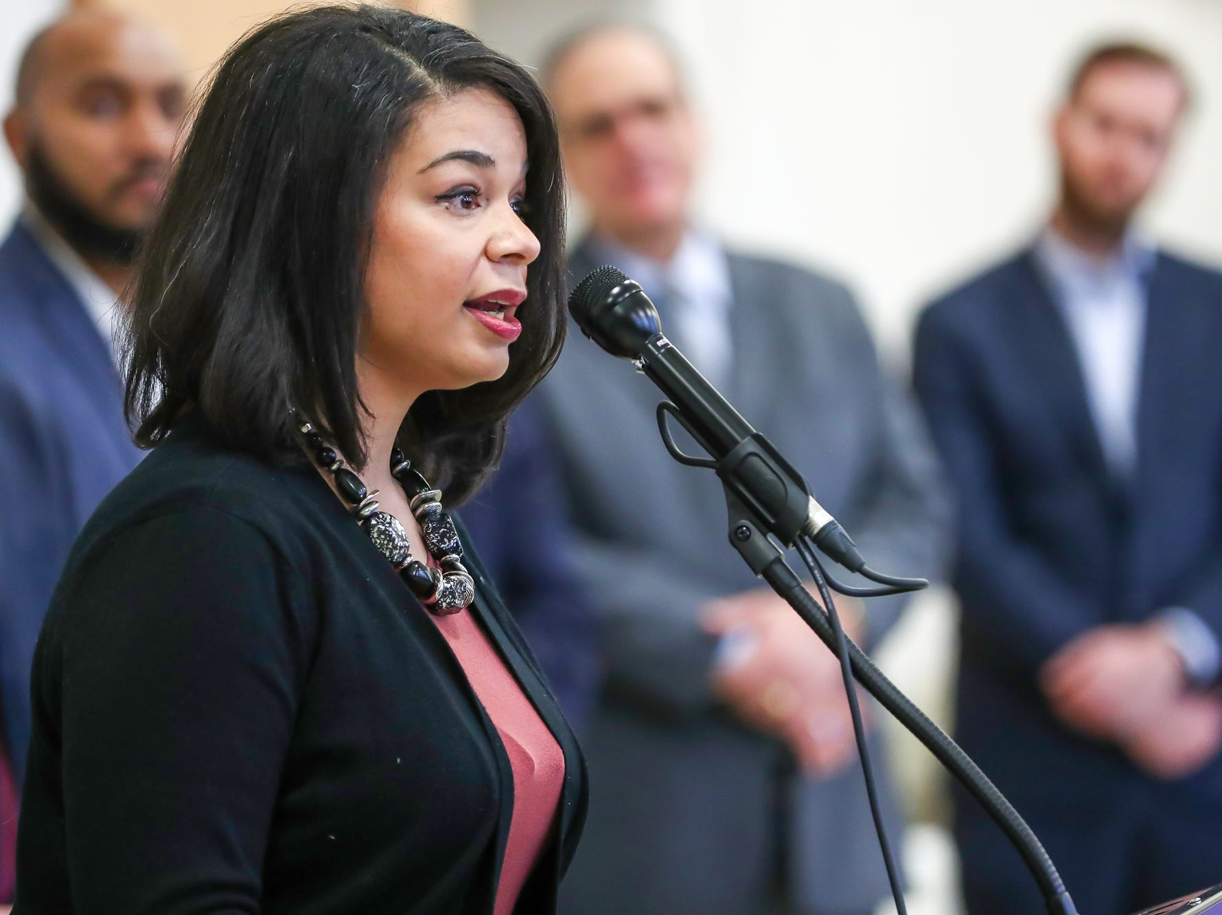 """Ashley Gurvitz, community development manager at Eastern Star Church, address the crowd gathered after the announcement on the start of a process to study body worn cameras on IMPD officers during a press conference at the Edna Martin Christian Center in Indianapolis on Monday, Feb. 4, 2019. We know our community can be better,"""" Gurvitz said. """"Although certain efforts have been made we have to continue to provide additional progress. Many are losing their lives because court is been held in the streets."""""""