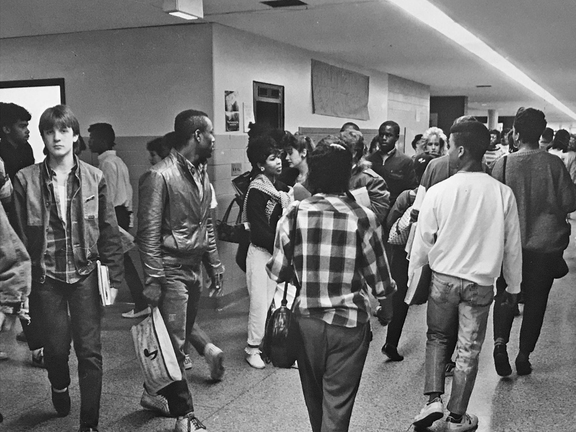 Students in the corridors at Arlington during a case change in 1986.