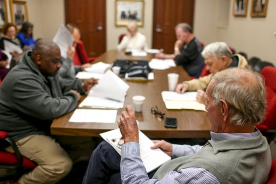Mayor Jerry Gist turns a page in the agenda during a city council meeting at Jackson City Hall on  Jan. 31, 2019.