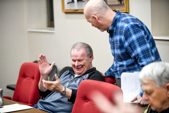 David Cisco (District 9), left, and Stan Pilot, director of planning department, right, joke around after finishing with the agenda at a city council meeting at Jackson City Hall in Jackson, Tenn., on Thursday, Jan. 31, 2019.