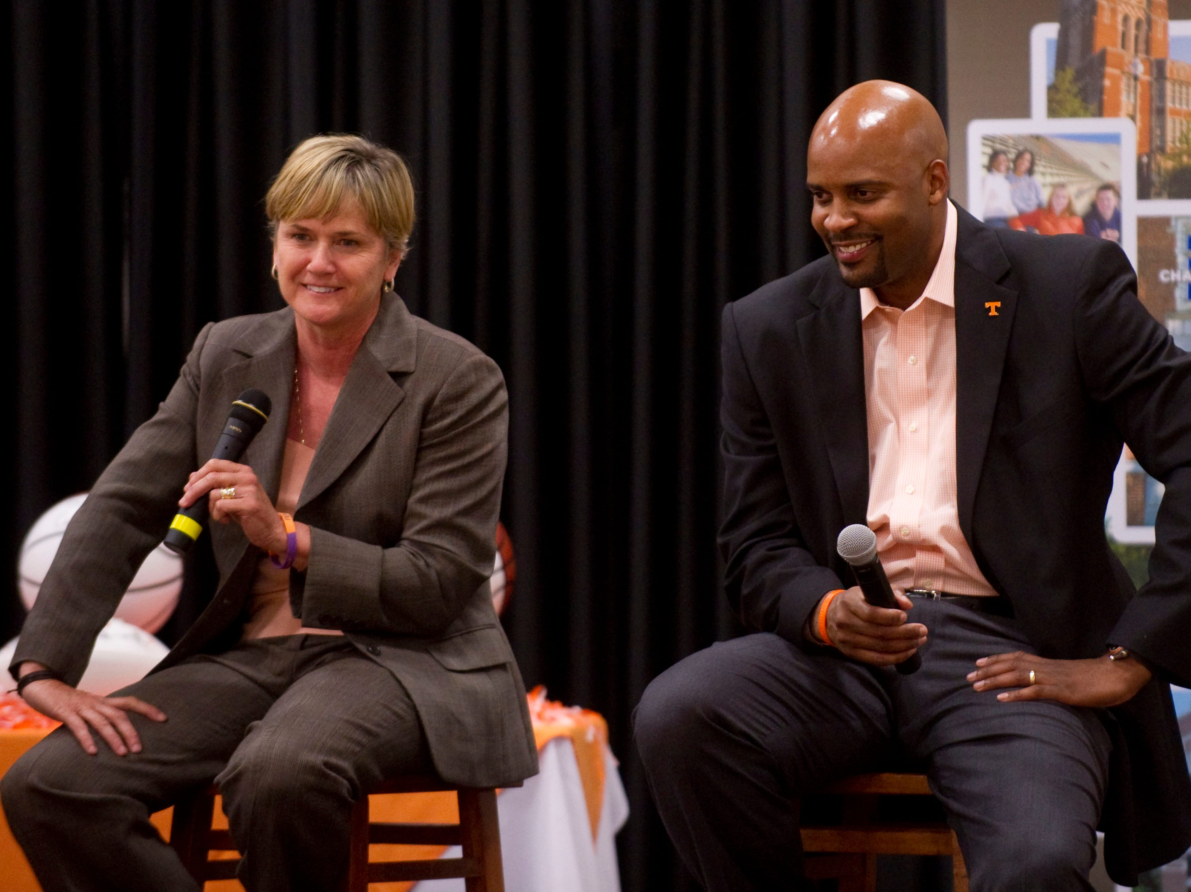 University of Tennessee head basketball coaches Holly Warlick, left, and Cuonzo Martin talk with guests attending the University of Tennessee's Alumni Association's Big Orange Caravan at Maryville College's Alumni Gym on Monday, May 7, 2012. The coaches answered questions and talked about the upcoming basketball season.