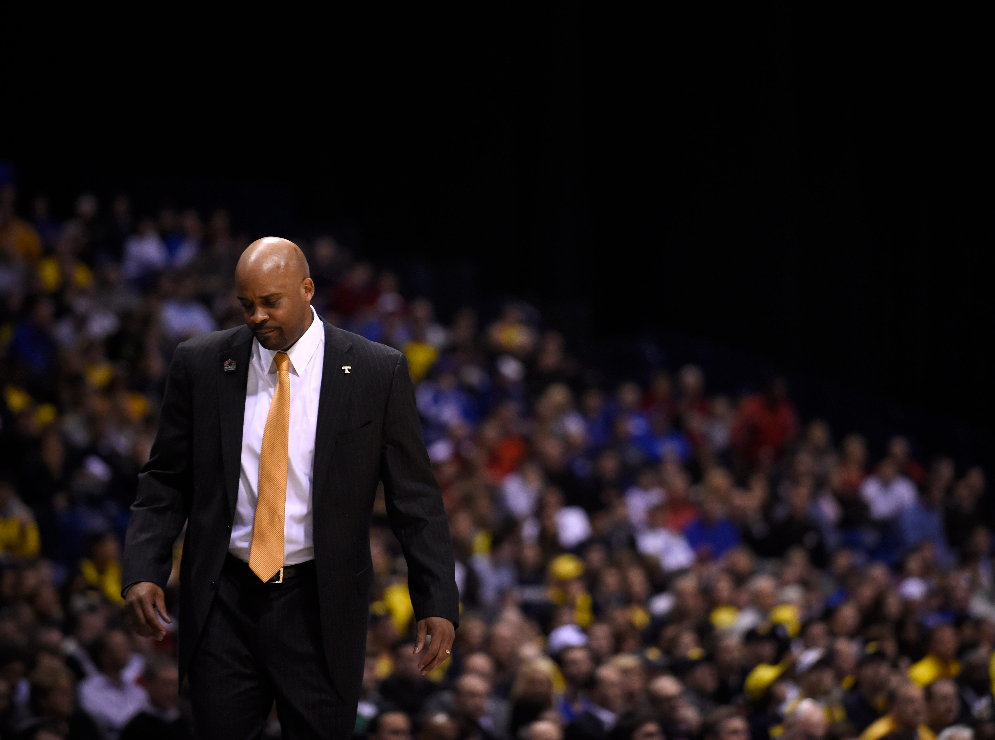 Tennessee head coach Cuonzo Martin walks towards the bench during an NCAA Sweet 16 game at Lucas Oil Stadium in Indianapolis, Ind. on Friday, March 28, 2014.