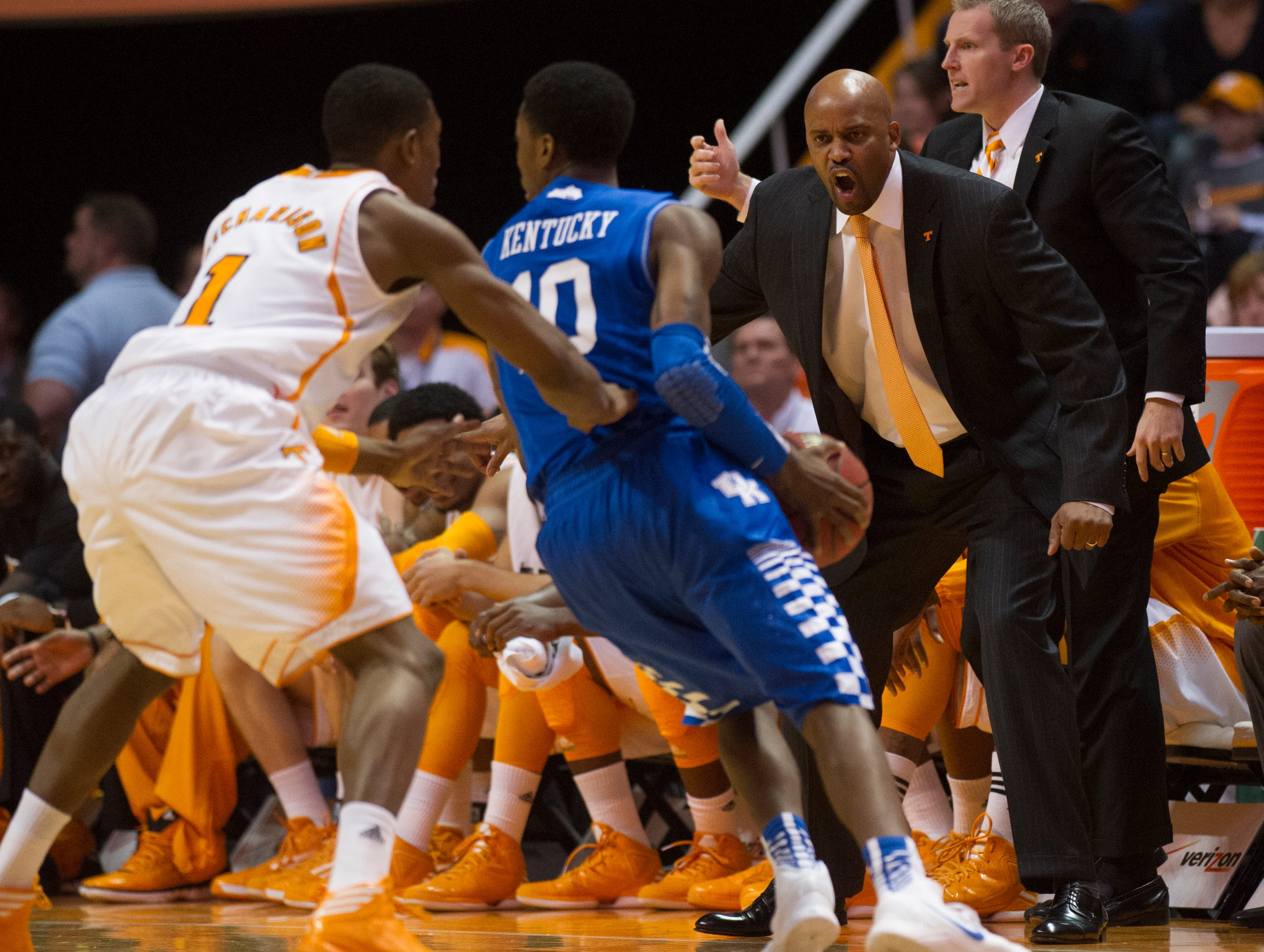 Tennessee head coach Cuonzo Martin calls to Tennessee guard Josh Richardson (1) as he guards Kentucky guard Archie Goodwin (10) during the first half at Thompson-Boling Arena Saturday, Feb. 16, 2013.