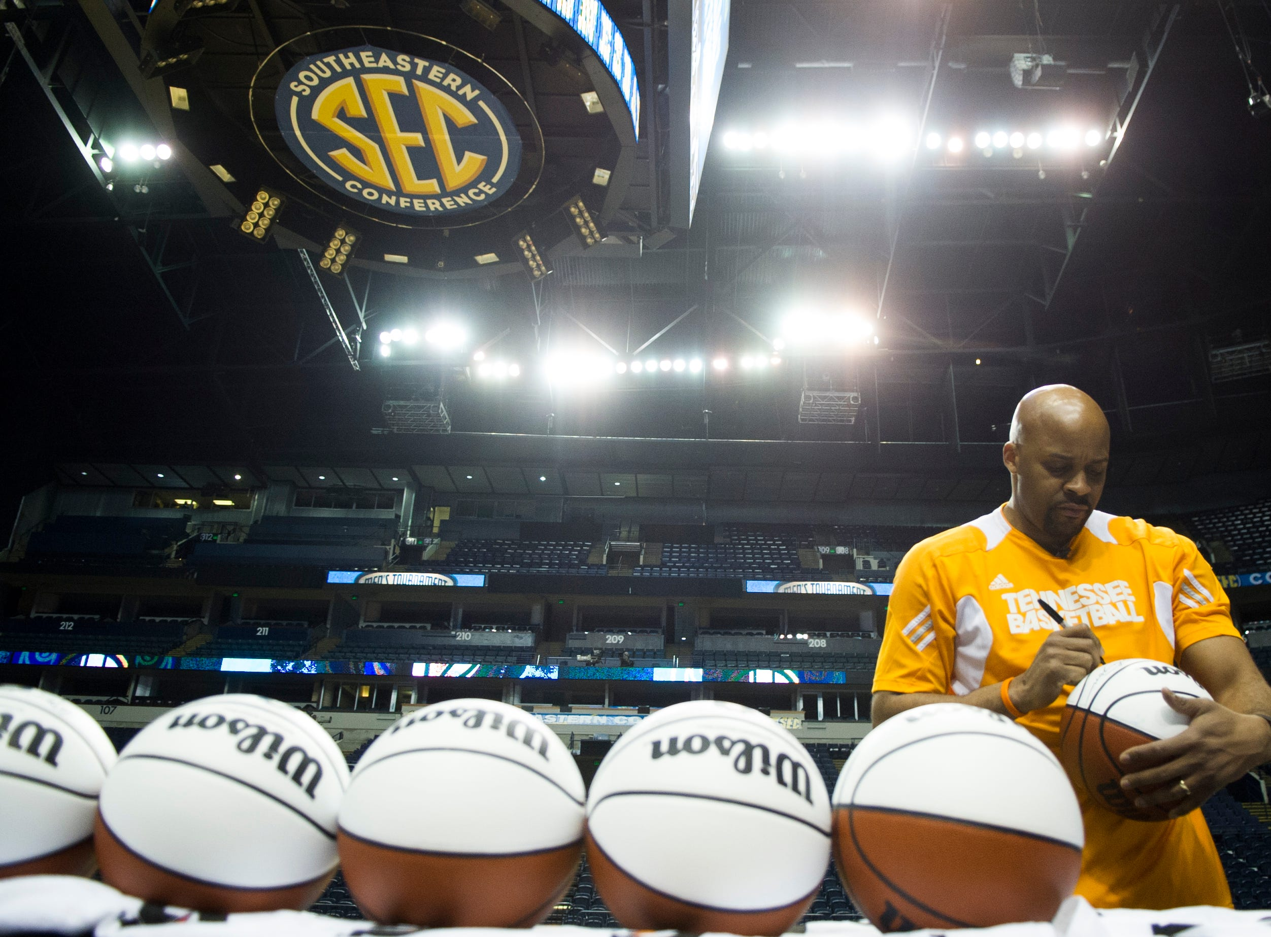 Tennessee head coach Cuonzo Martin signs basketballs during practice before the 2013 SEC Men's Basketball Tournament at Bridgestone Arena in Nashville Wednesday, March 13, 2013. Tennessee will play the winner of the Mississippi State and South Carolina Game which takes place Wednesday evening.