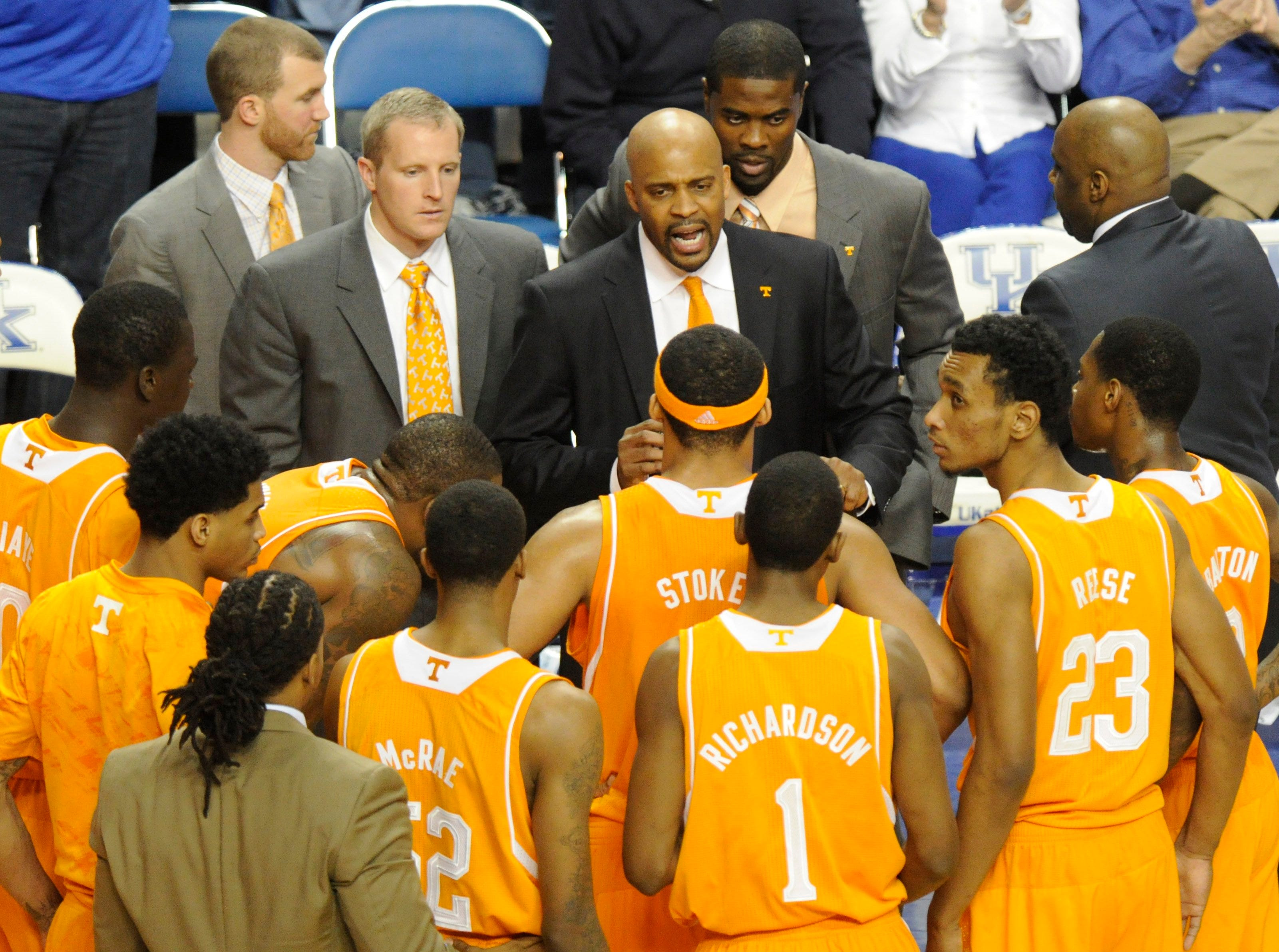 Tennessee head coach Cuonzo Martin huddles with his players on the sideline during a timeout in the second half at University of Kentucky's Rupp Arena in Lexington on Saturday, Jan. 18, 2014. Tennessee lost 74-66.