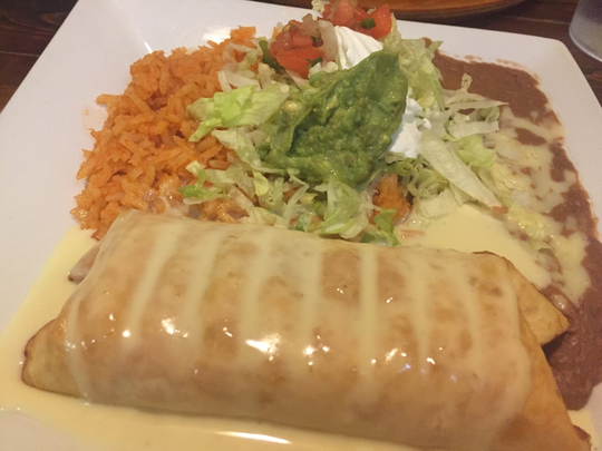 The chimichanga at Potrillos Taqueria & Mexican Grill comes with beans and rice.