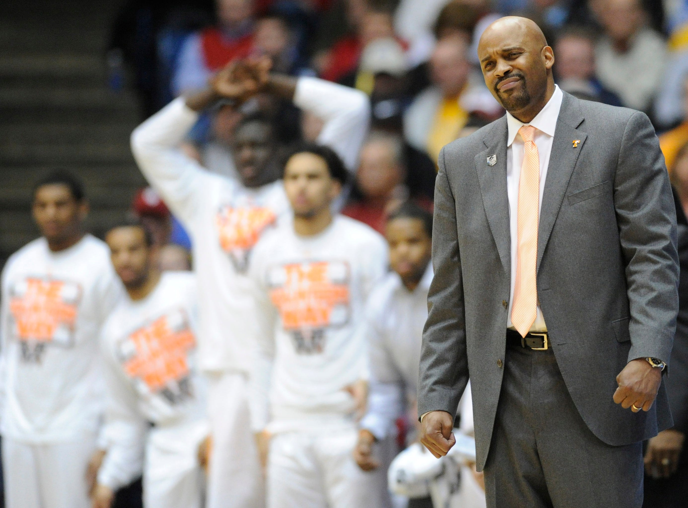 Tennessee head coach Cuonzo Martin and the Tennessee bench react to a missed shot by the Vols during the first half of an NCAA tournament First Four play-in game against Iowa at the University of Dayton Arena in Dayton, Ohio on Wednesday, March 19, 2014.