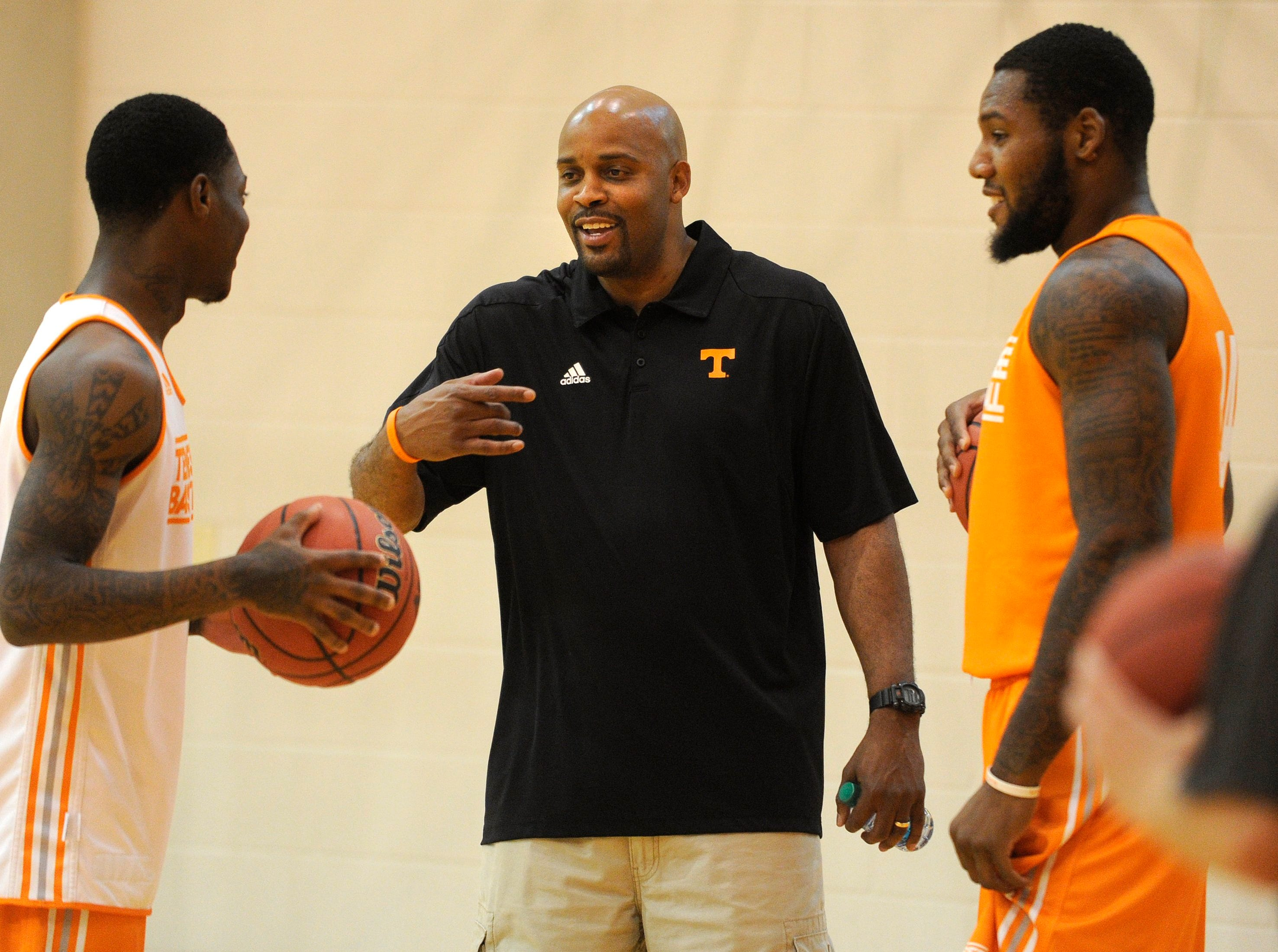 Head coach Cuonzo Martin chats with players during the men's basketball team's practice at University of Tennessee's Pratt Pavillion in Knoxville on Wednesday, Oct. 2, 2013.