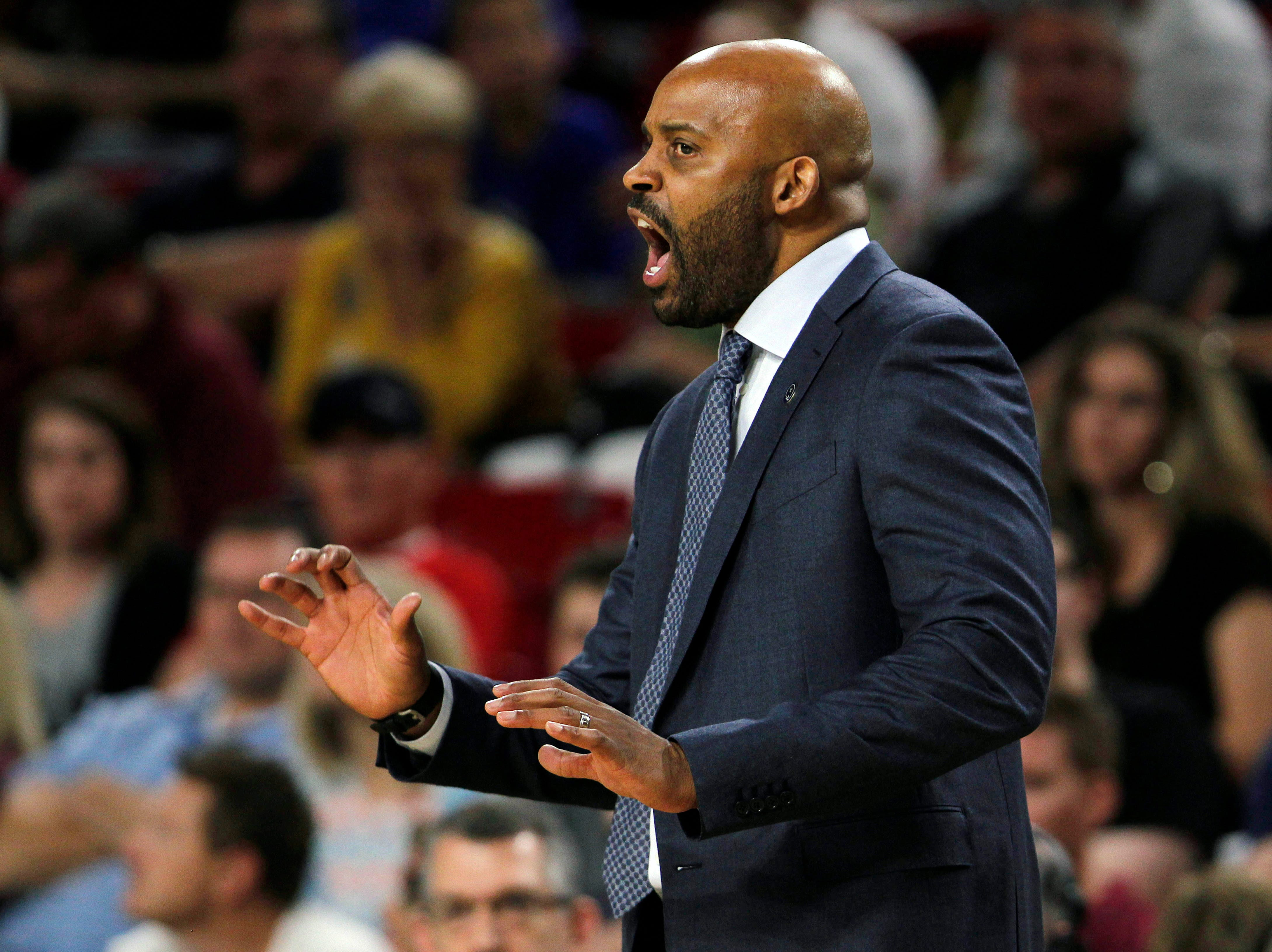 California coach Cuonzo Martin yells instructions to his players from the sidelines during the second half of the team's NCAA college basketball game against Arizona State in Tempe, Ariz., Saturday, March 5, 2016.