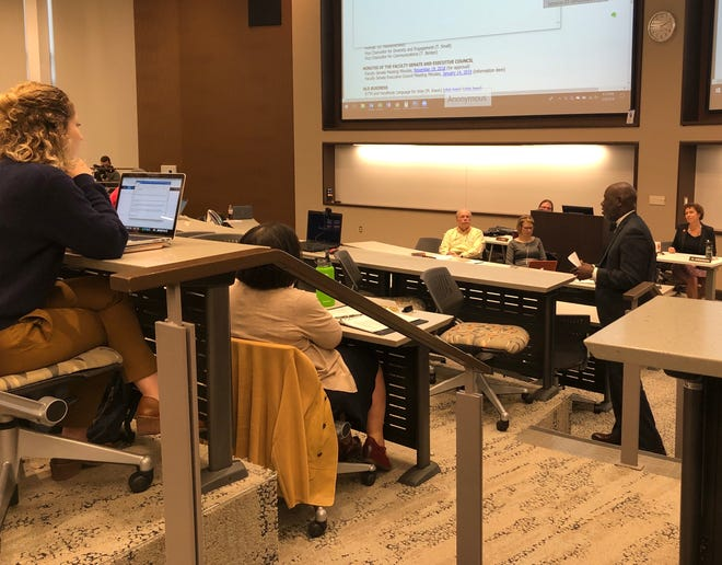 Tyvi Small, interim vice chancellor for diversity and engagement, right, speaks to the University of Tennessee Faculty Senate on Monday, Feb. 4, 2019.