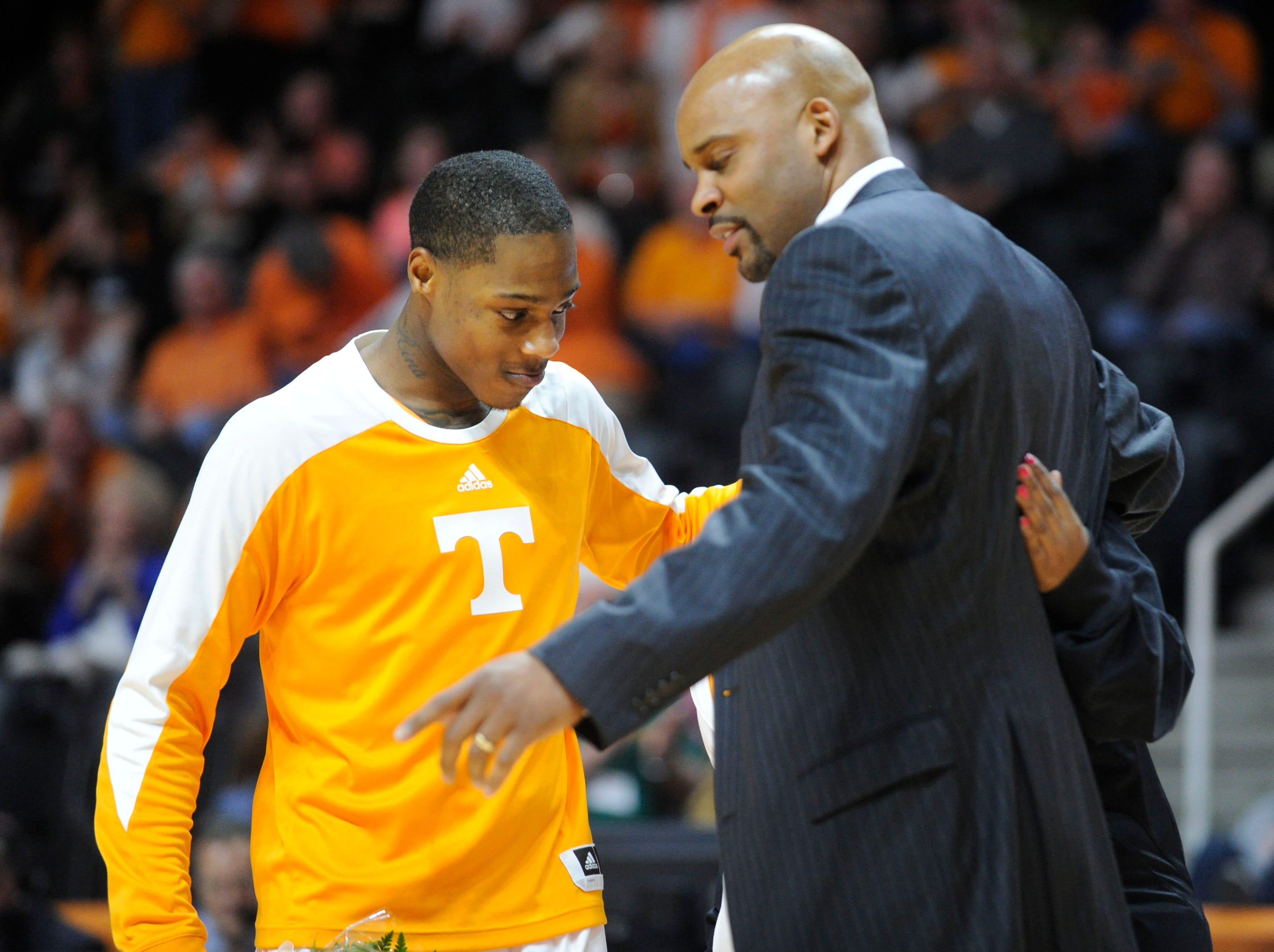 Tennessee guard Antonio Barton (2), left, gets a hug from Tennessee head coach Cuonzo Martin as he is recognized on senior day before Tennessee's game against Missouri at the Thompson-Boling Arena in Knoxville on Saturday, March 8, 2014.