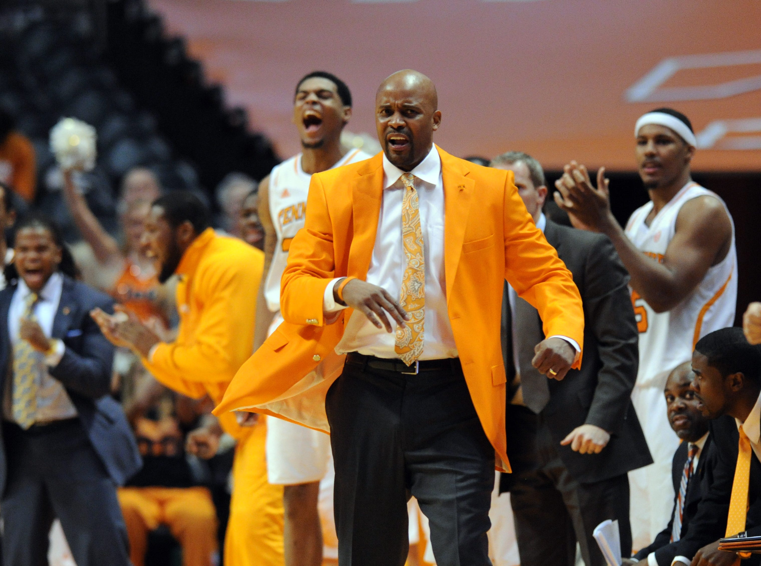 Tennessee head coach Cuonzo Martin celebrates with his players after a Jordan McRae three pointer in the second half against Wichita State at Thompson-Boling Arena Thursday, Dec. 13, 2012.