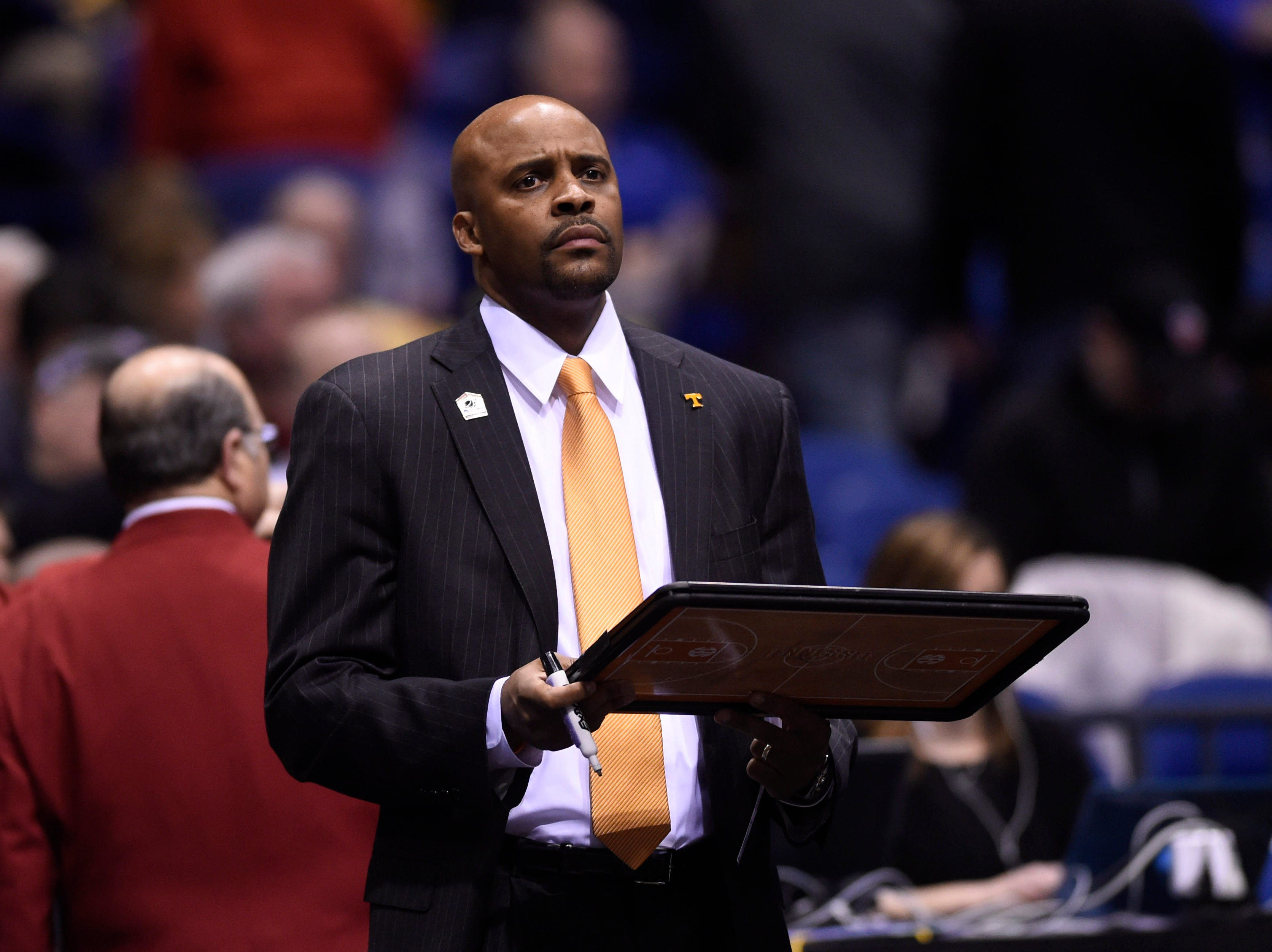 Tennessee head coach Cuonzo Martin stares towards the court before an NCAA Sweet 16 game at Lucas Oil Stadium in Indianapolis, Ind. on Friday, March 28, 2014.