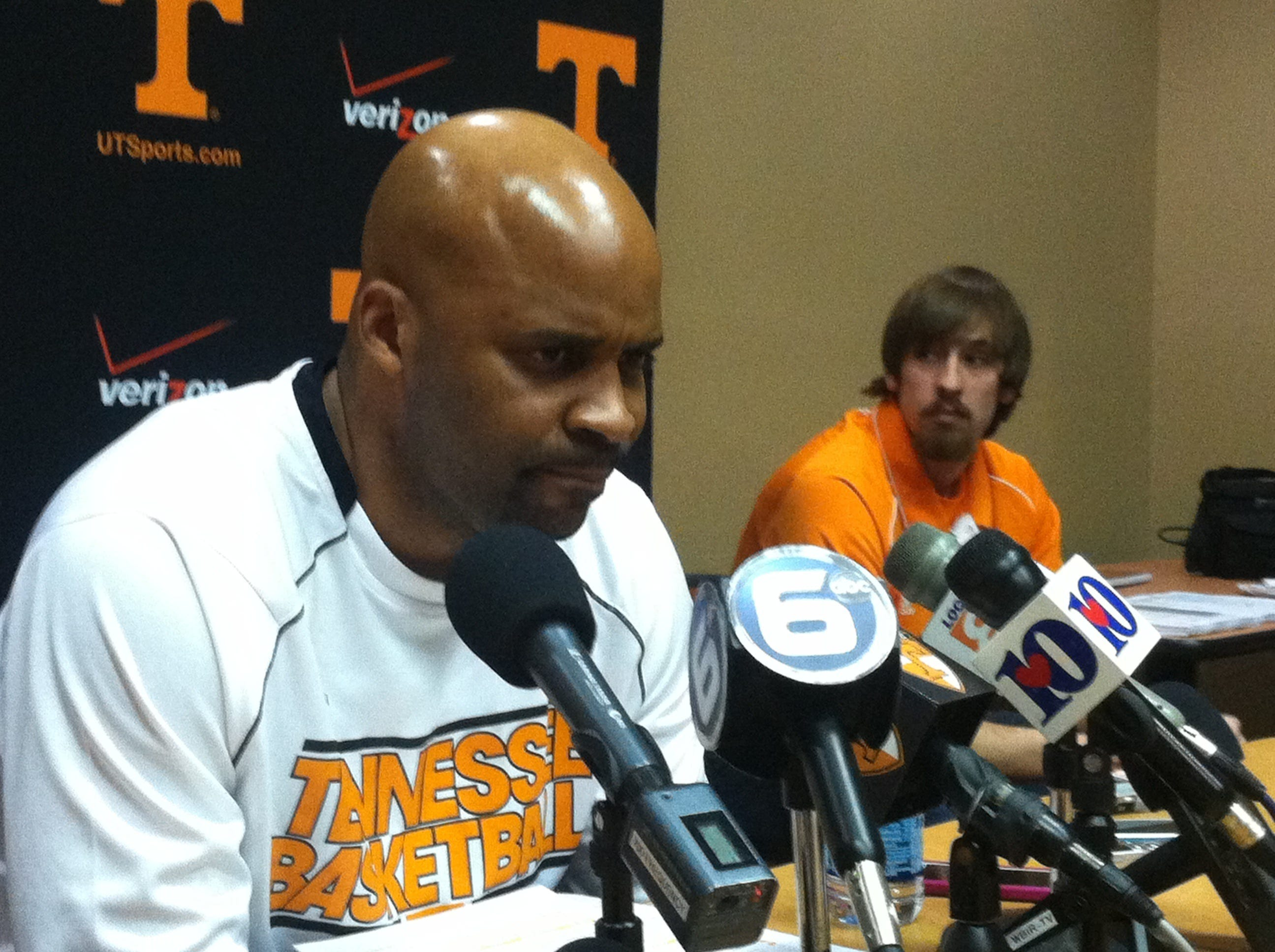 Skylar McBee watches as Coach Cuonzo Martin answers questions from the media at Thompson -Boling Arena on Feb. 24, 2013.