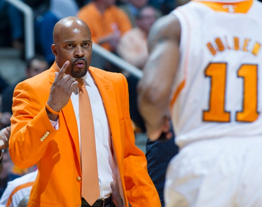 Tennessee head coach Cuonzo Martin talks with guard Trae Golden (11) in the first half against Vanderbilt at Thompson-Boling Arena Tuesday, Jan. 29, 2013.