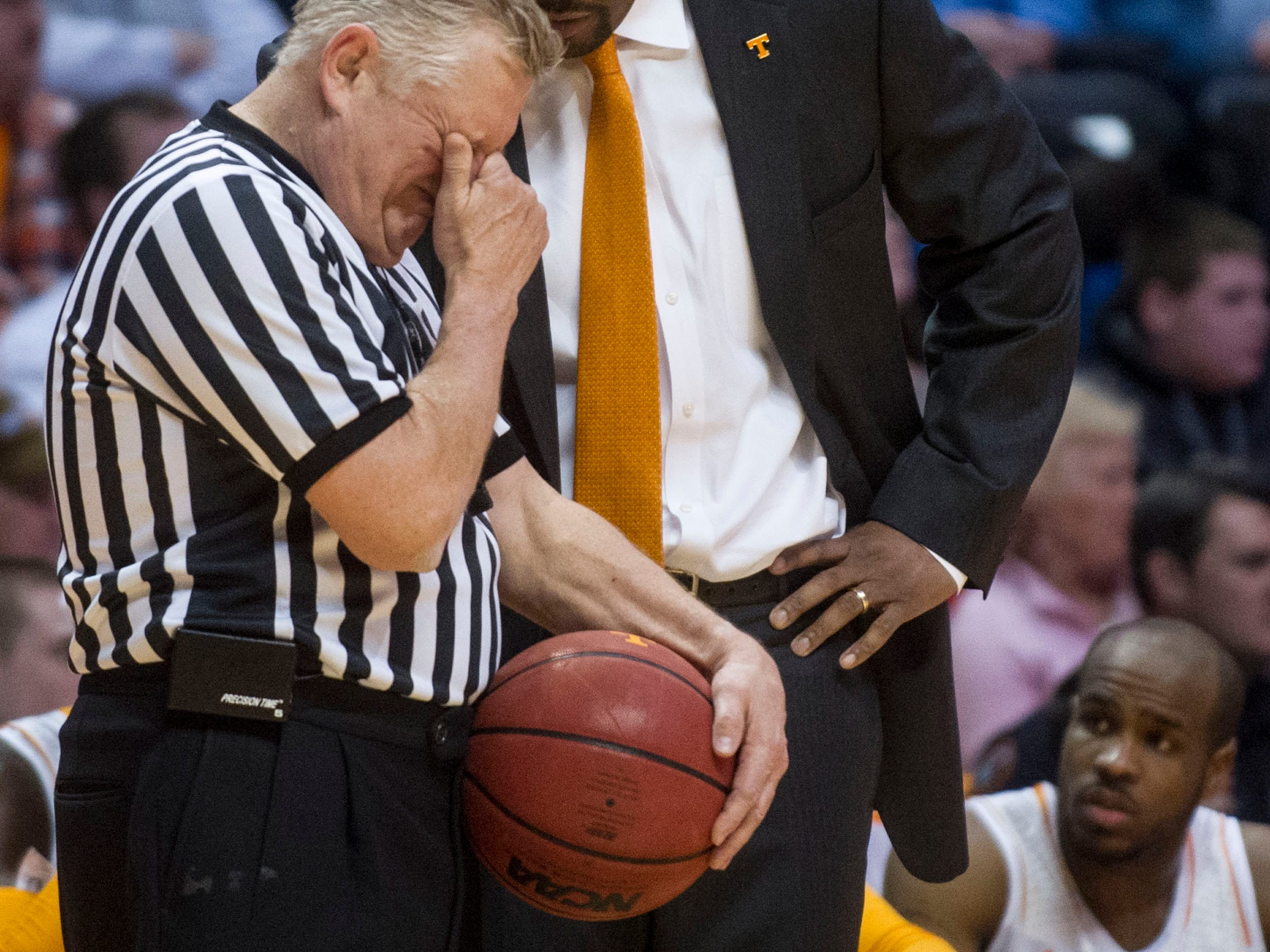 Tennessee head coach Cuonzo Martin speaks with an official during the game against LSU at Thompson-Boling Arena on Tuesday, February 19, 2013. Tennessee wins against LSU, 82-72.