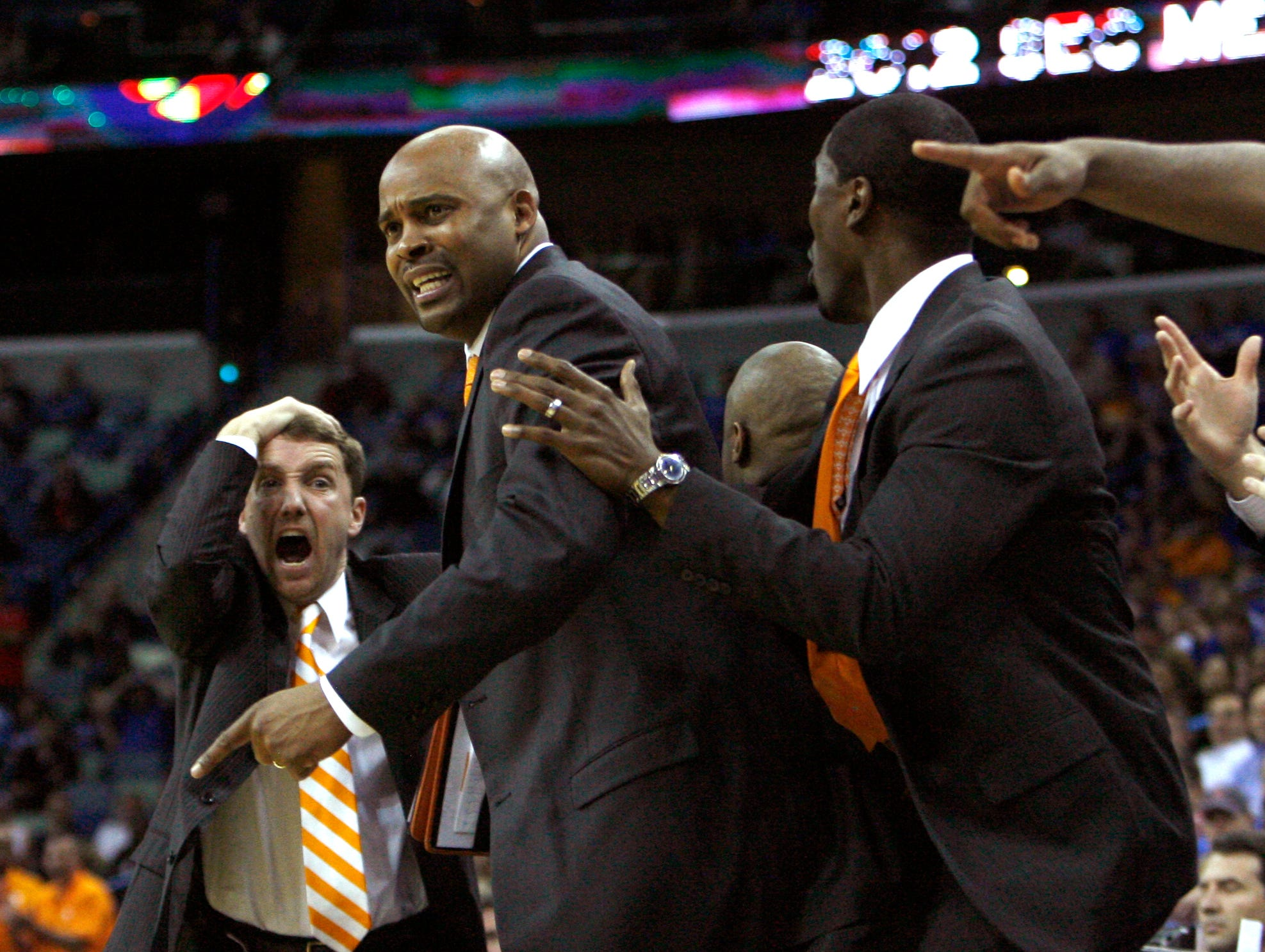 Tennessee head coach Cuonzo Martin, center, shows frustration after Ole Miss was given possession of the ball when it was knocked out of bounds during overtime during the SEC Men's Basketball Tournament at the New Orleans Arena in New Orleans, La., Friday, March 9, 2012.