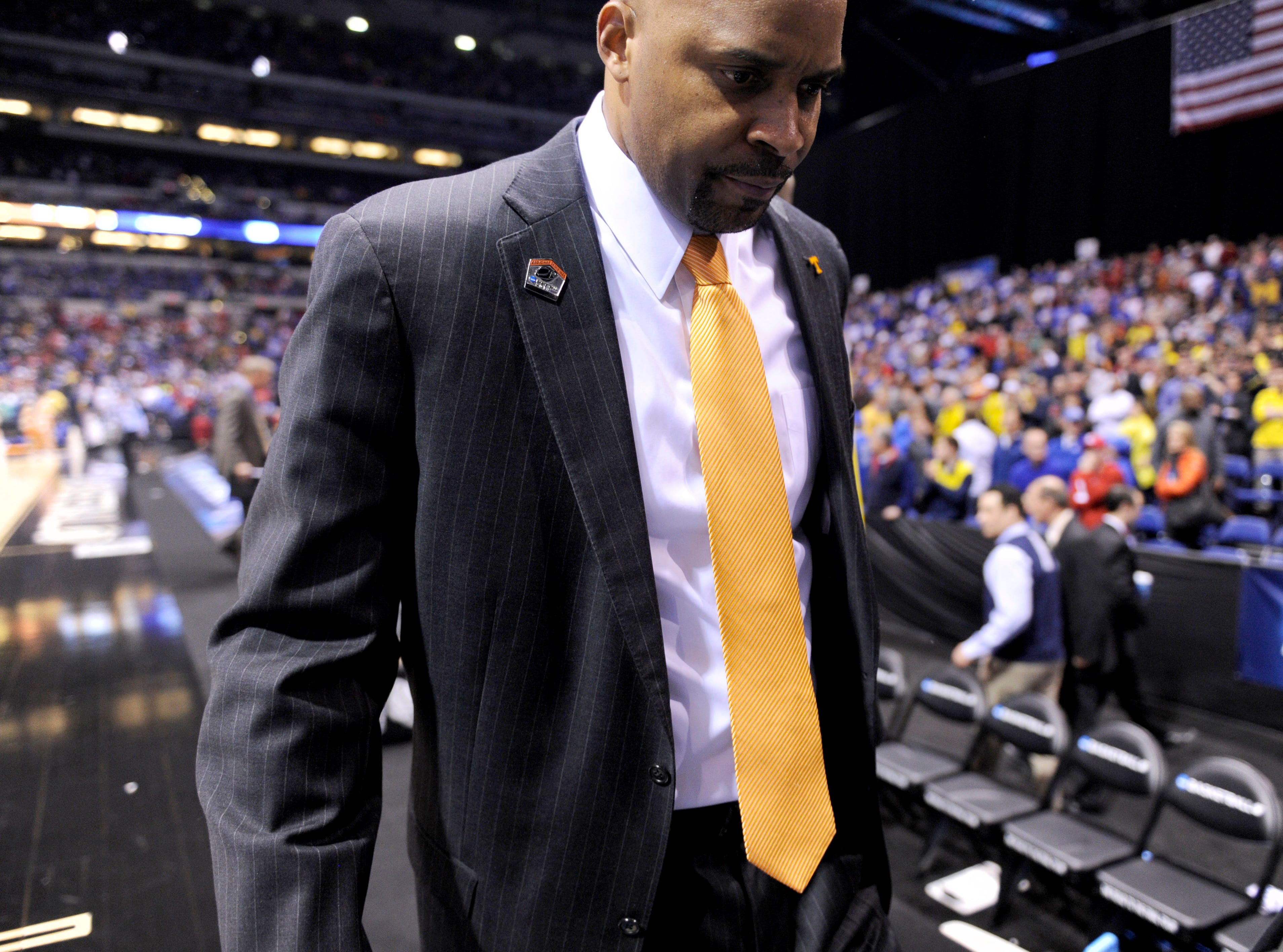 Tennessee head coach Cuonzo Martin leaves the court after losing to Michigan 73-71 in an NCAA Sweet 16 game at Lucas Oil Stadium in Indianapolis, Ind. on Friday, March 28, 2014.