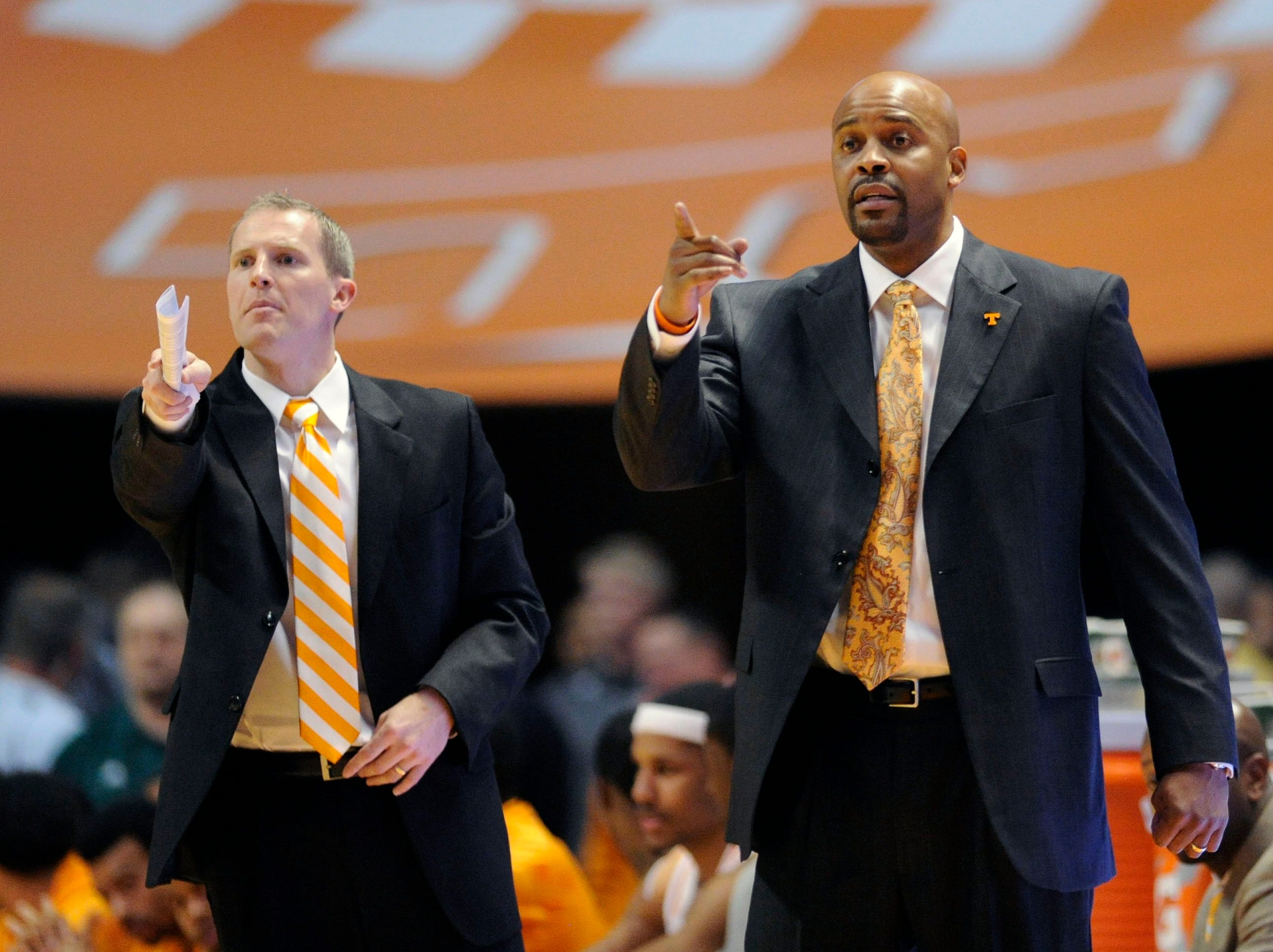 Tennessee assistant coach Kent Williams and Tennessee head coach Cuonzo Martin signal to players from the sideline during the first half against Texas A&M at the Thompson-Boling Arena in Knoxville on Saturday, Jan. 11, 2014.