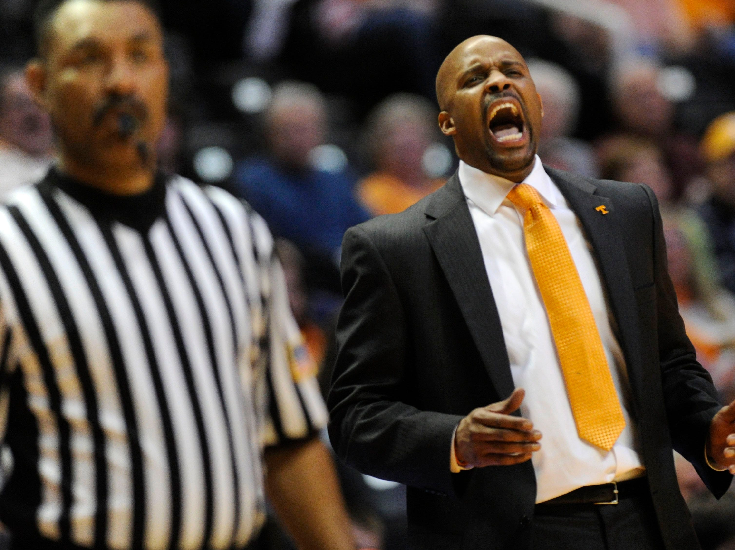 Tennessee head coach Cuonzo Martin reacts as the Vols defeat Ole Miss 86-70 during the second half at the Thompson-Boling Arena in Knoxville on Wednesday, Jan. 29, 2014.