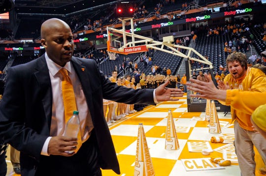 Tennessee head coach Cuonzo Martin greets fans as he leaves the court after the 67-56 win over Florida on Saturday, Jan. 7, 2012.