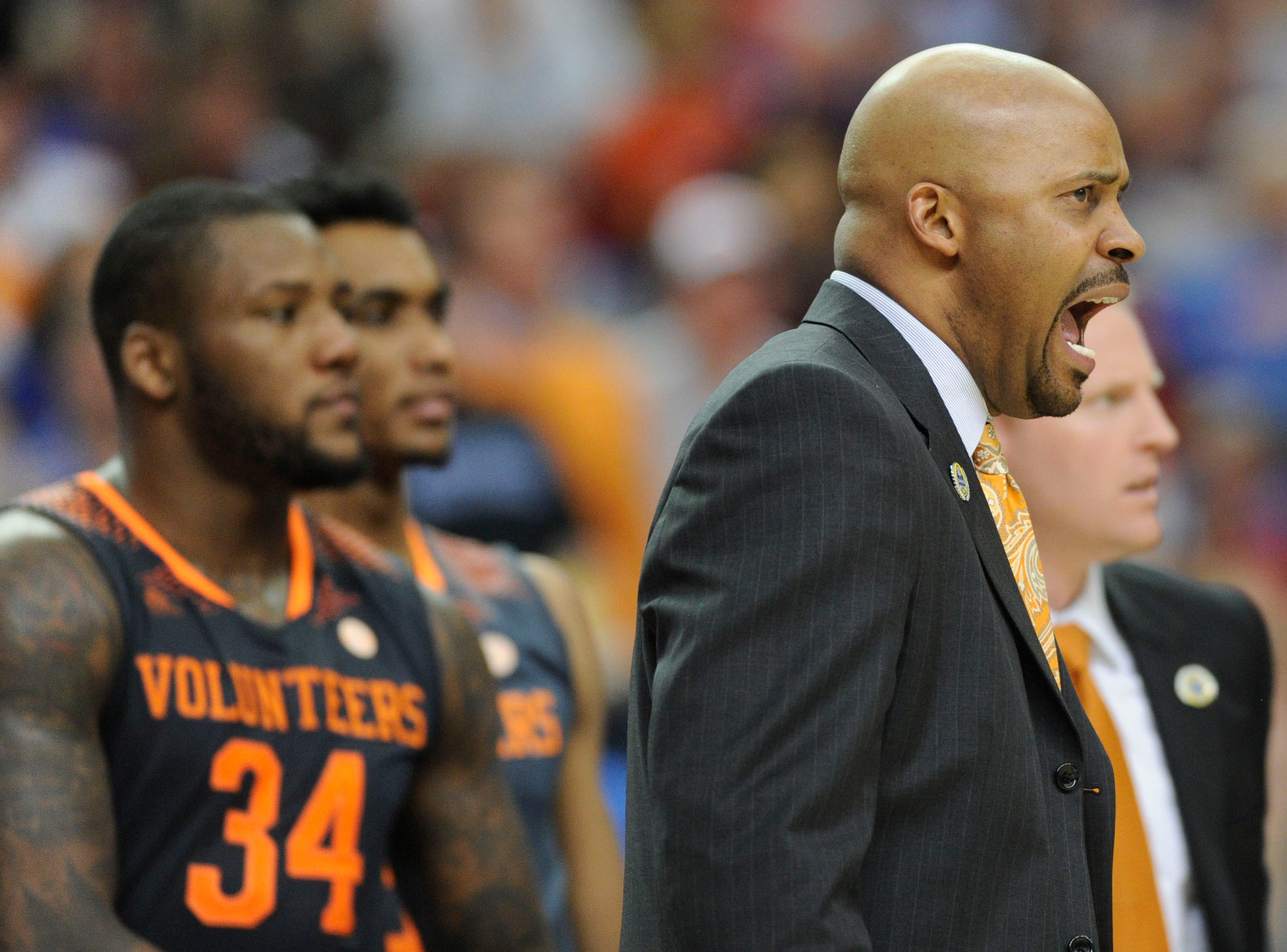 Tennessee head coach Cuonzo Martin reacts during the second half of an SEC tournament semifinal game at the Georgia Dome in Atlanta on Saturday, March 15, 2014. Tennessee lost 56-49.