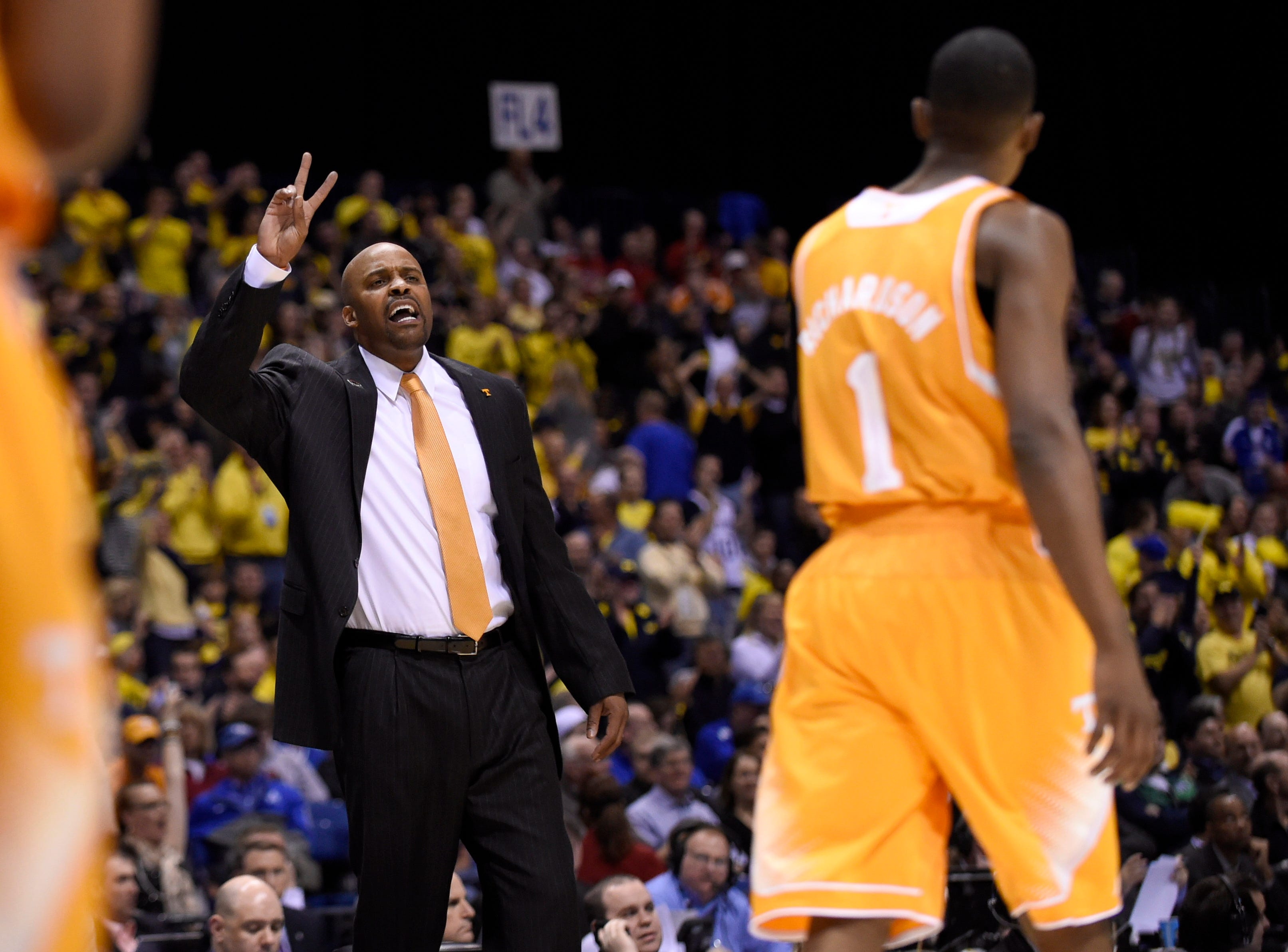 Tennessee head coach Cuonzo Martin shouts instructions  during an NCAA Sweet 16 game at Lucas Oil Stadium in Indianapolis, Ind. on Friday, March 28, 2014.