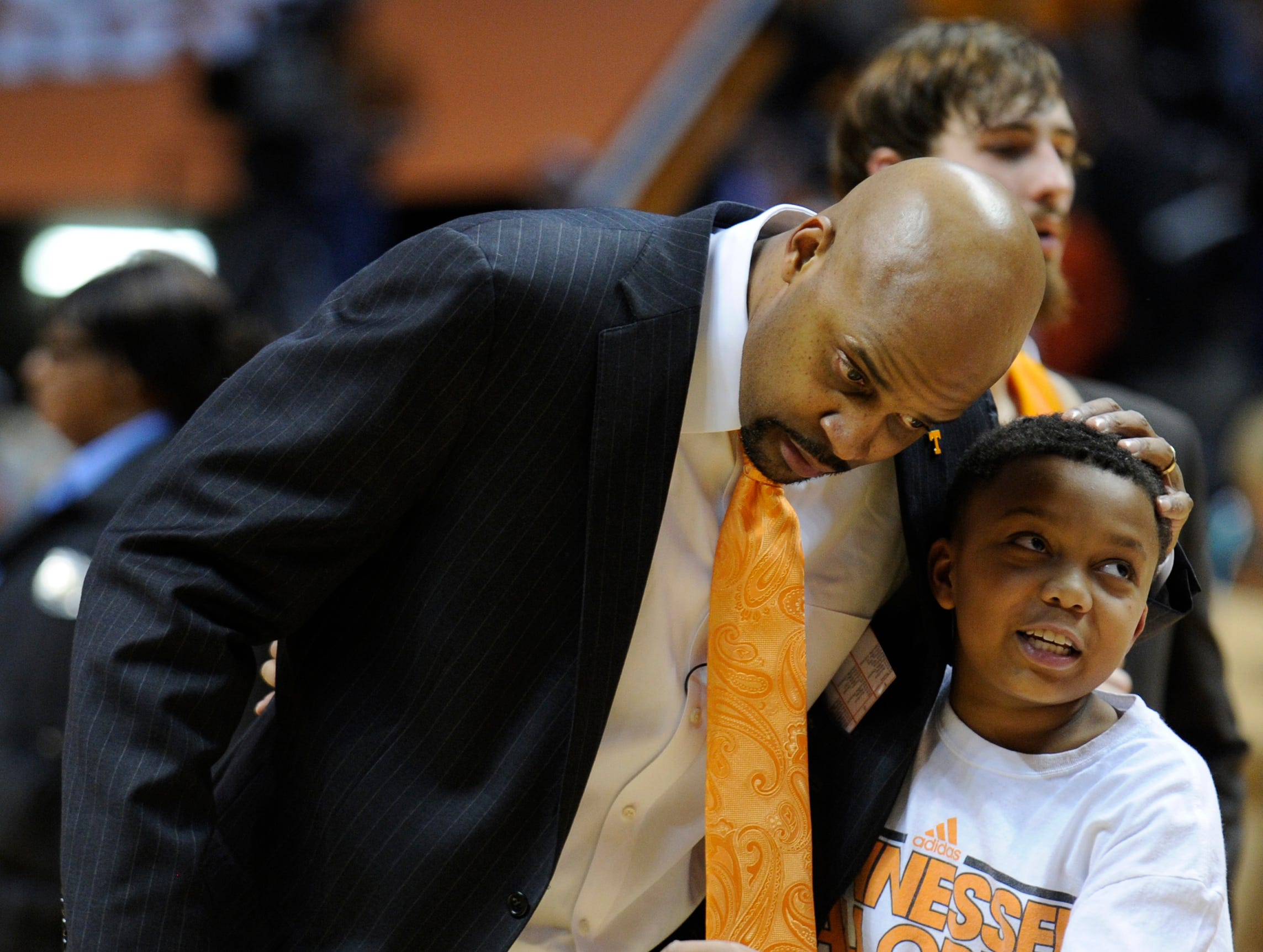 Tennessee head coach Cuonzo Martin is greeted by his son Chase after the game against Memphis at Thompson-Boling Arena, Friday, Jan. 4, 2012. UT lost 85-80.