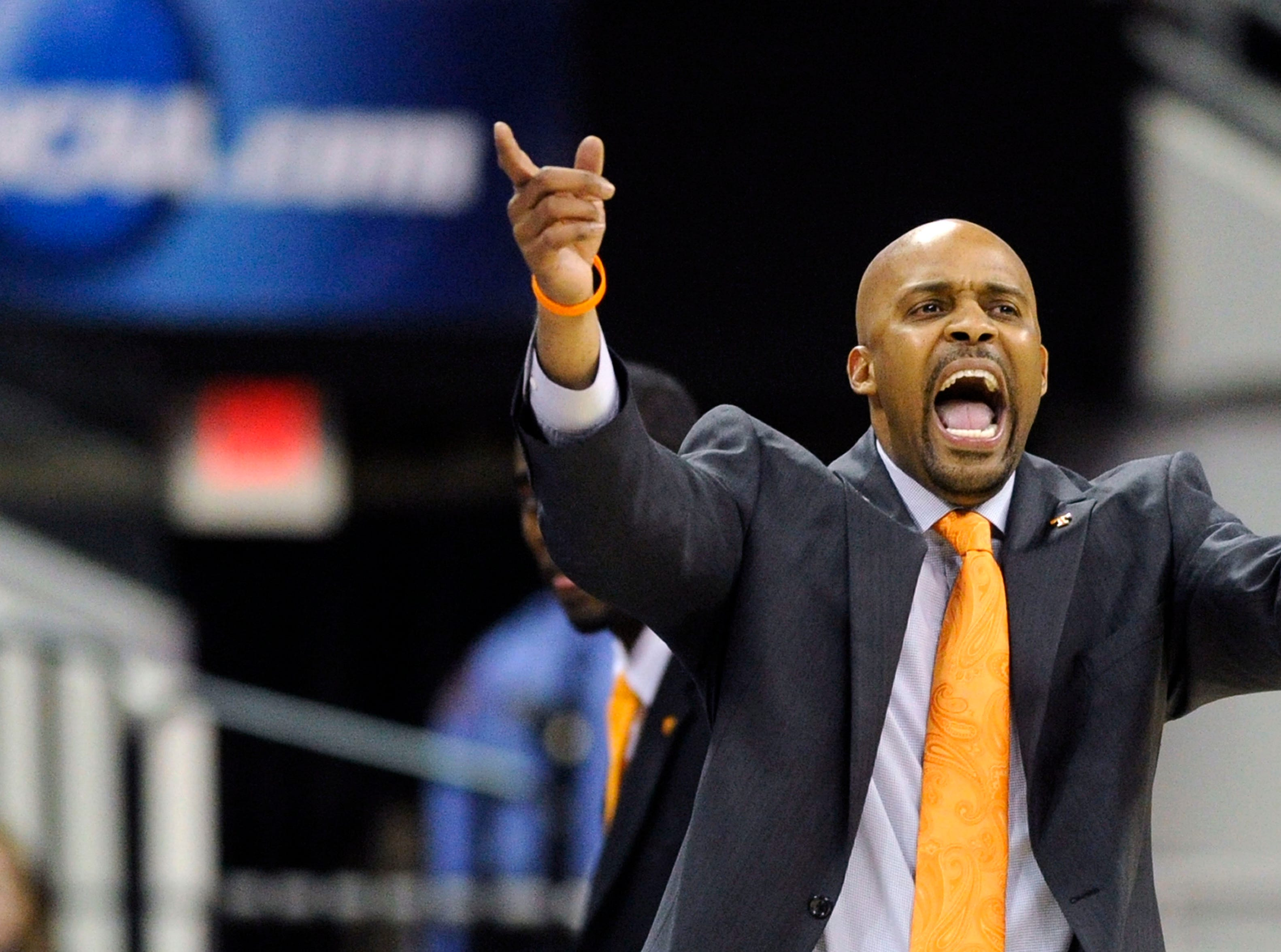 Tennessee head coach Cuonzo Martin shouts from the sideline during the first half of a third-round NCAA tournament game at the PNC Arena in Raleigh, N.C. on Sunday, March 23, 2014.