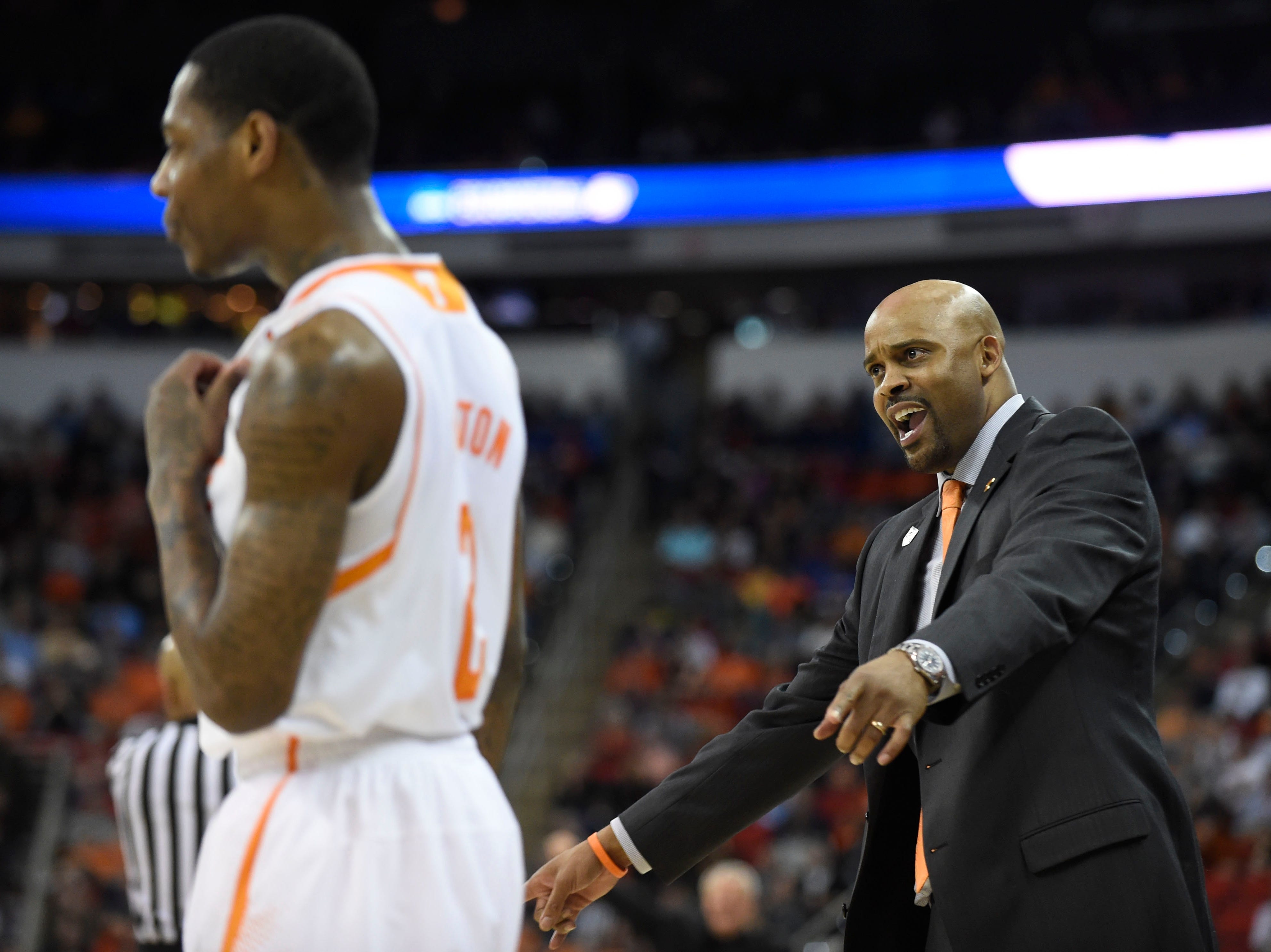 Tennessee head coach Cuonzo Martin talks to his players from the sideline during the second half of a third-round NCAA tournament game at the PNC Arena in Raleigh, N.C. on Sunday, March 23, 2014. Tennessee won 83-63.
