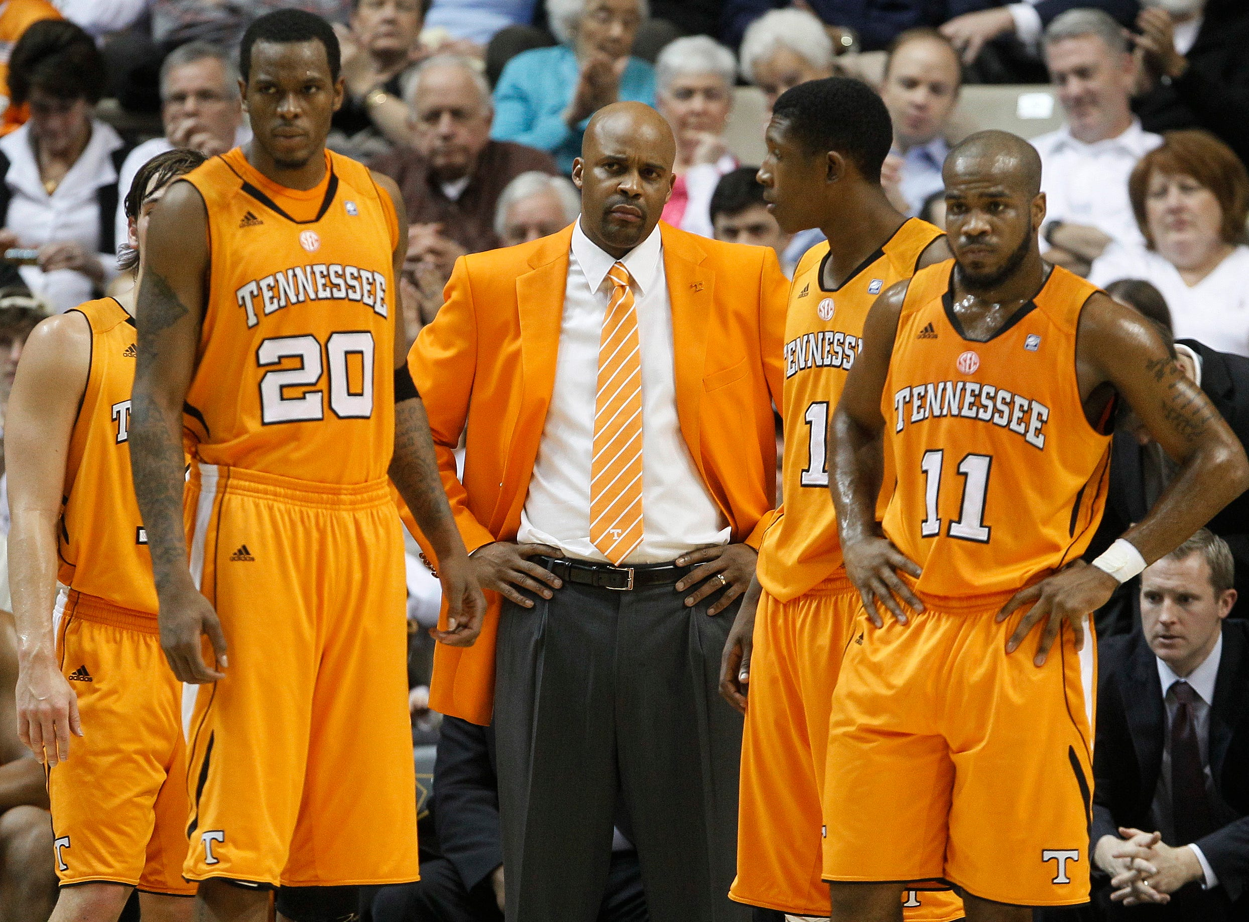 Tennessee head coach Cuonzo Martin, center, watches from the bench along with Kenny Hall (20), Josh Richardson (1) and Trae Golden (11) in the first half of an NCAA college basketball game against Vanderbilt on Tuesday, Jan. 24, 2012, in Nashville, Tenn.