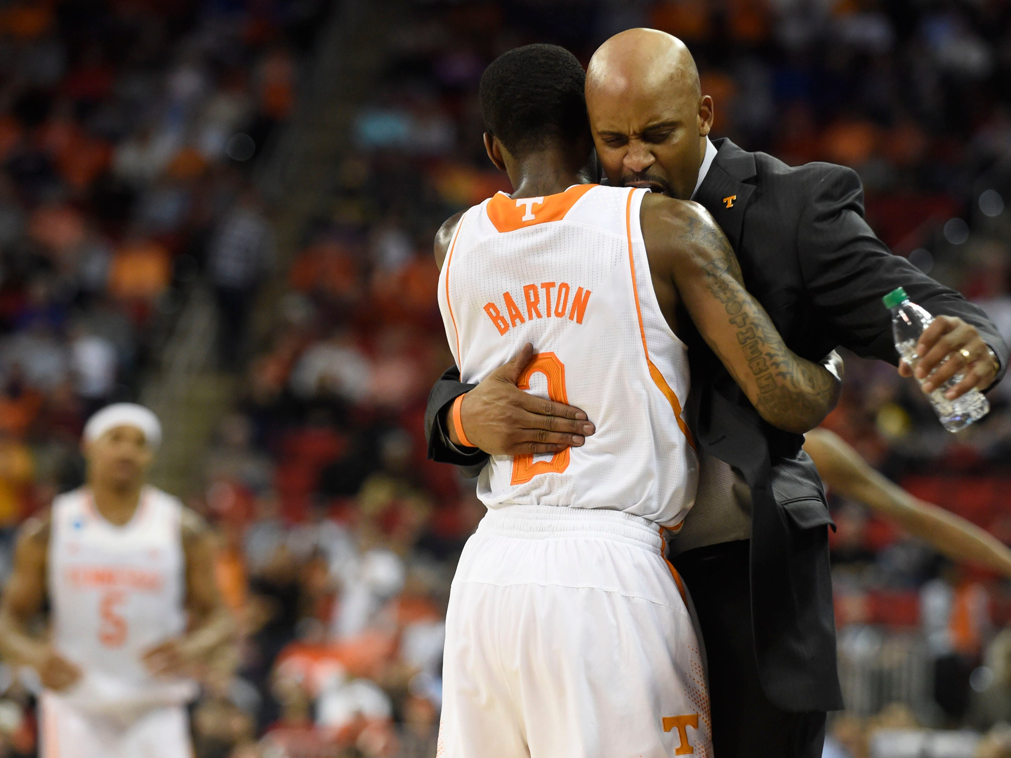 Tennessee guard Antonio Barton (2) hugs Tennessee head coach Cuonzo Martin after Tennessee secured a Sweet Sixteen berth by defeating Mercer 83-63 in a third-round NCAA tournament game at the PNC Arena in Raleigh, N.C. on Sunday, March 23, 2014.