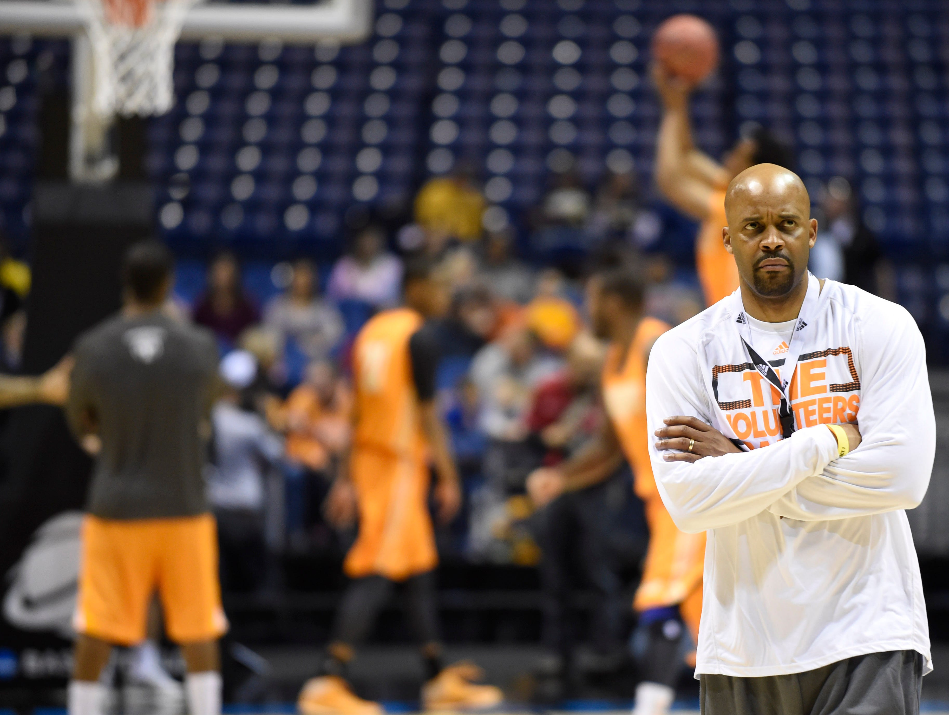 Tennessee head coach Cuonzo Martin watches his team practice before Tennessee's NCAA Sweet Sixteen game against Michigan at Lucas Oil Stadium in Indianapolis, Ind. on Thursday, March 27, 2014.