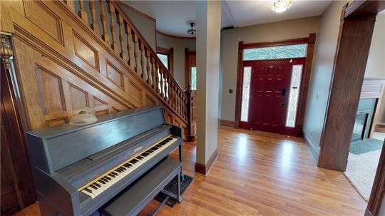 Built in 1920, this five bedroom four and a half bath home is packed with character, from the wood floors to the original woodwork seen throughout. The rooms hold high ceilings and illuminating floor to ceiling windows, but upgrades seen in the kitchen give the home a more modern feel.