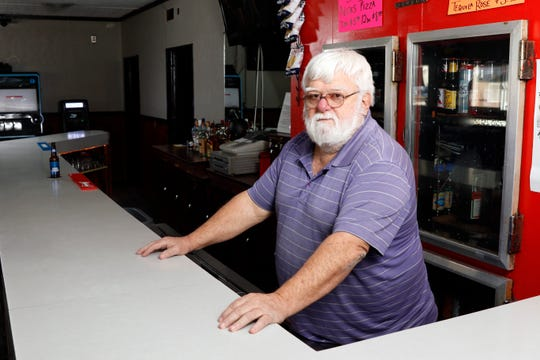 Mike Ankrom, manager and former owner of the what is now the Dog House Tavern, stands behind the bar at the neighborhood bar Monday, Feb. 4, 2019, in Lancaster. Ankrom sold the bar, formerly the Dawg House Pub, to his nephew and three other people. The bar briefly closed for interior renovations. More work to the inside the bar is coming and work on the exterior is expected to begin in the spring.