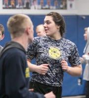Eliana Bommarito of Hartland has a 6-6 varsity record wrestling against boys.