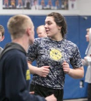 Eliana Bommarito of Hartland has a 6-6 varsity record wrestling against boys.