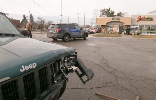 The driver of a Ford Flex struck a parked Jeep in the parking lot of businesses near Cross St. on Grand River Ave. in Brighton Monday, Feb. 4, 2019, then hit the building occupied by Intimate Ideas and Gus's Carry Out.