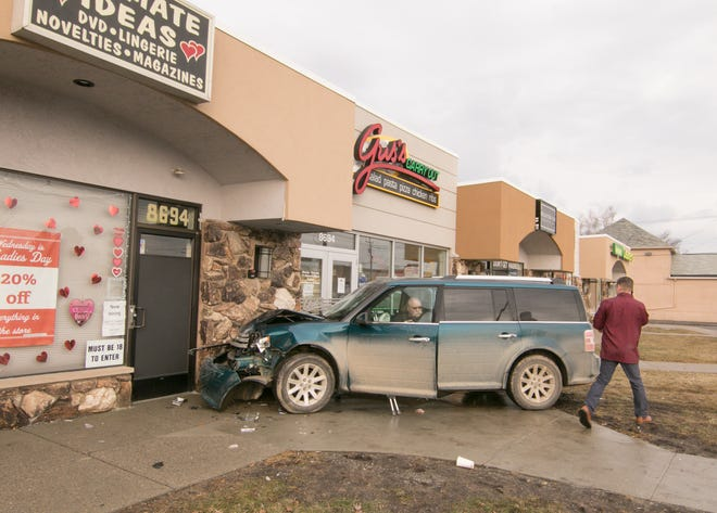 The driver of this Ford Flex collided with a Jeep parked in front of businesses in the city of Brighton Monday, Feb. 4, 2019 while turning left on Cross from northbound Grand River Ave. and came into contact with the building housing Intimate Ideas and Gus's Carry Out, according to Brighton Police Sgt. Mike Mitchell. The driver suffered minor injuries to his hand.