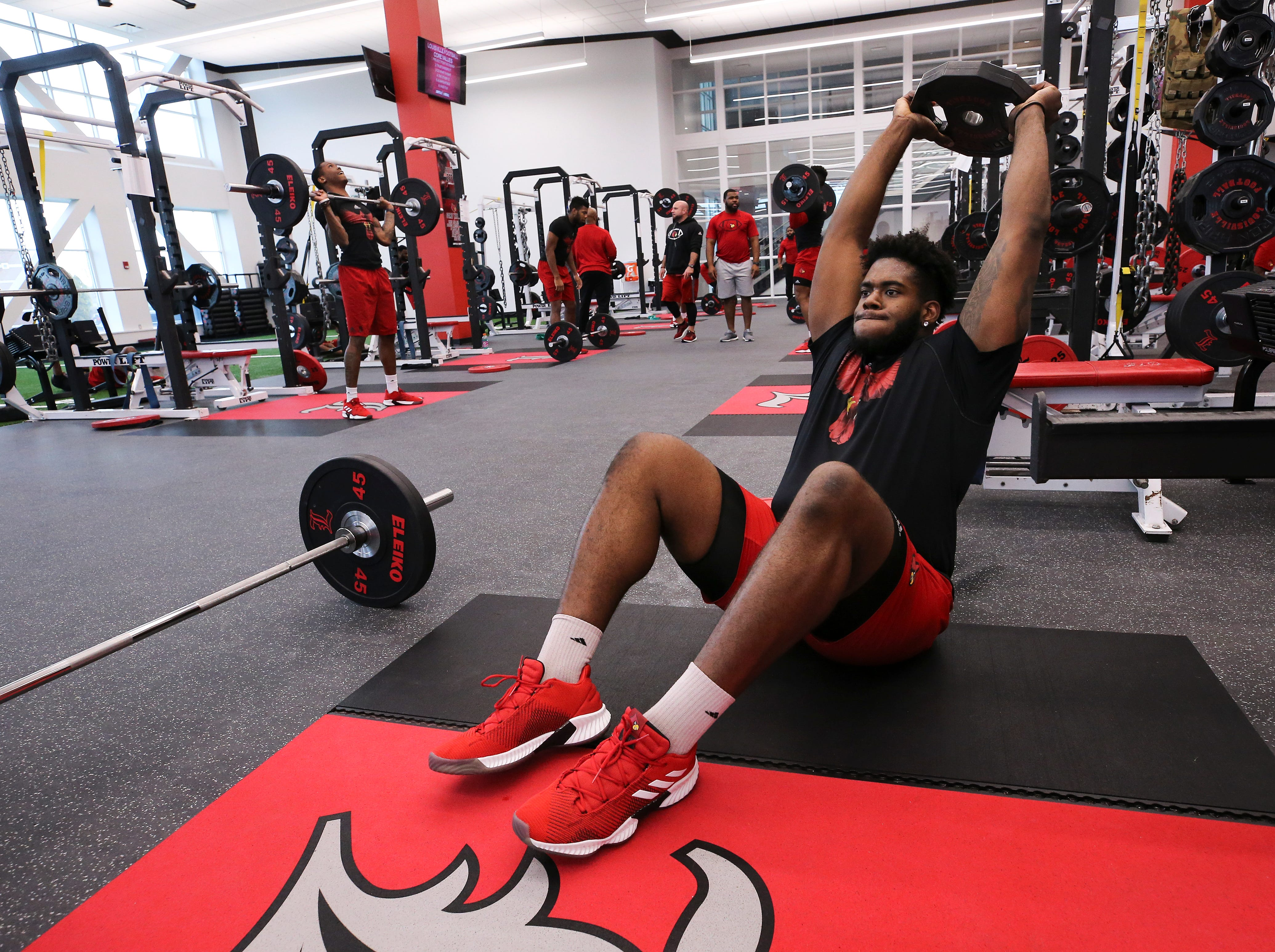 U of L's Jean-Luc Childs works out during strength and conditioning at the Schnellenberger Complex. Feb. 4, 2019