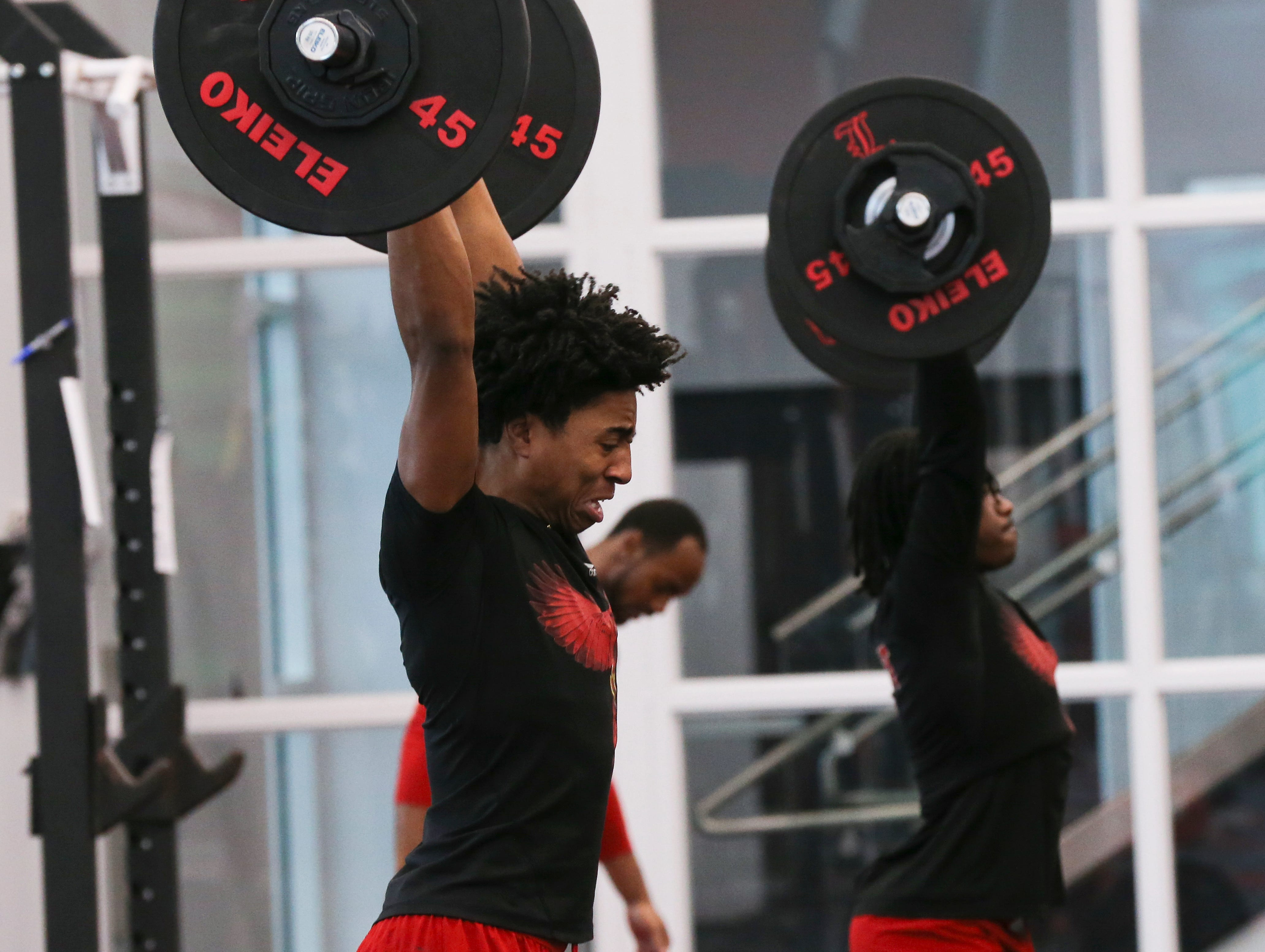 U of L wide receiver Dez Fitzpatrick, left, works out during strength and conditioning at the Schnellenberger Complex.
