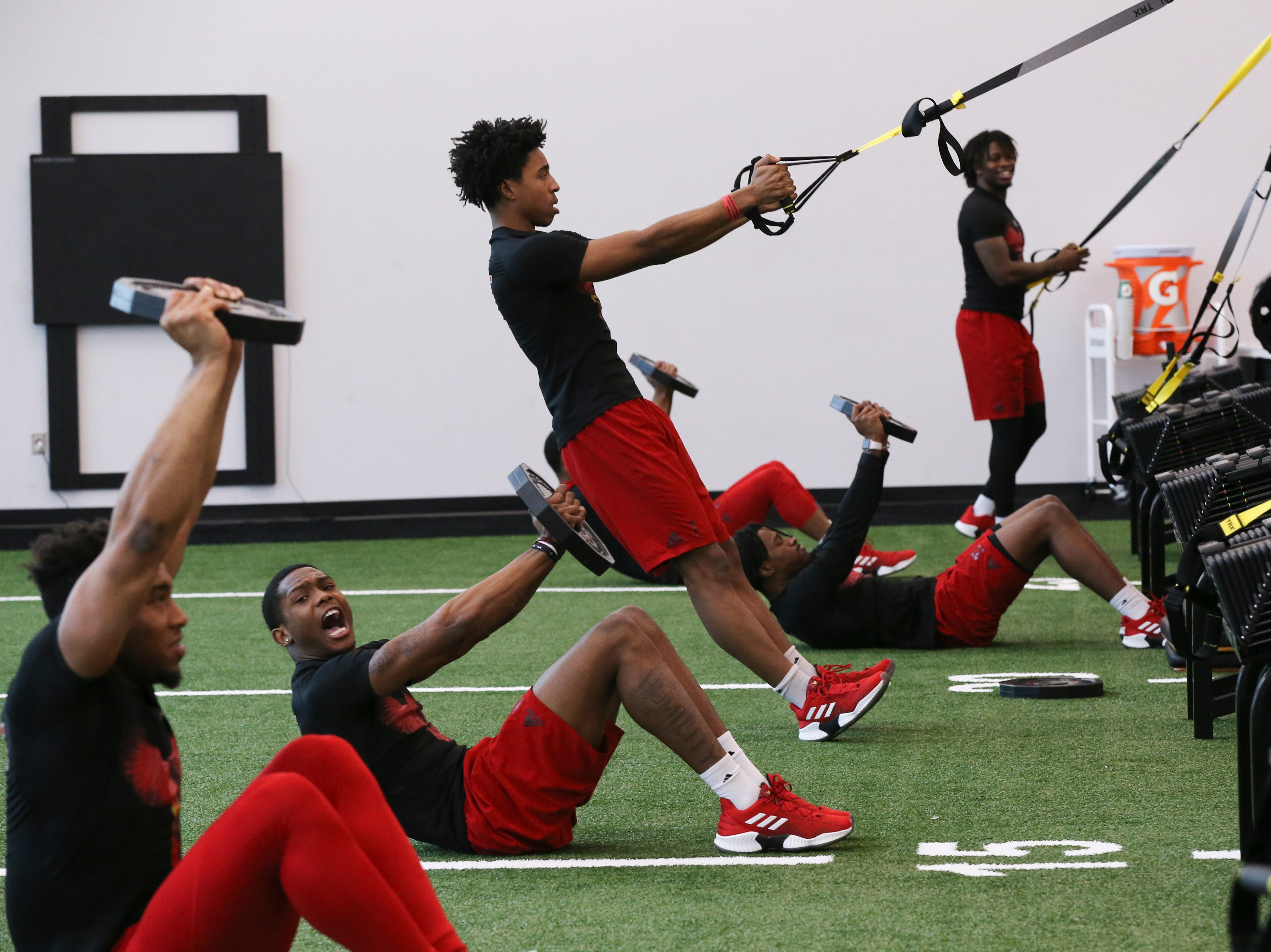 U of L wide receiver Dez Fitzpatrick, center, works out during strength and conditioning at the Schnellenberger Complex.