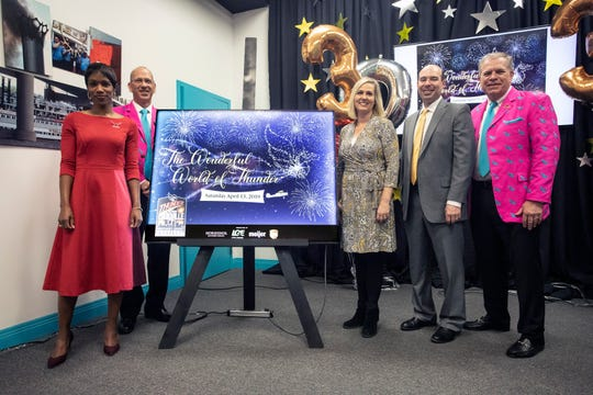 Representatives from Thunder Over Louisville's corporate sponsors pose with Derby Festival CEO Mike Berry during a Monday morning press conference that announced details of the beloved event's 30th year. February 4, 2019.