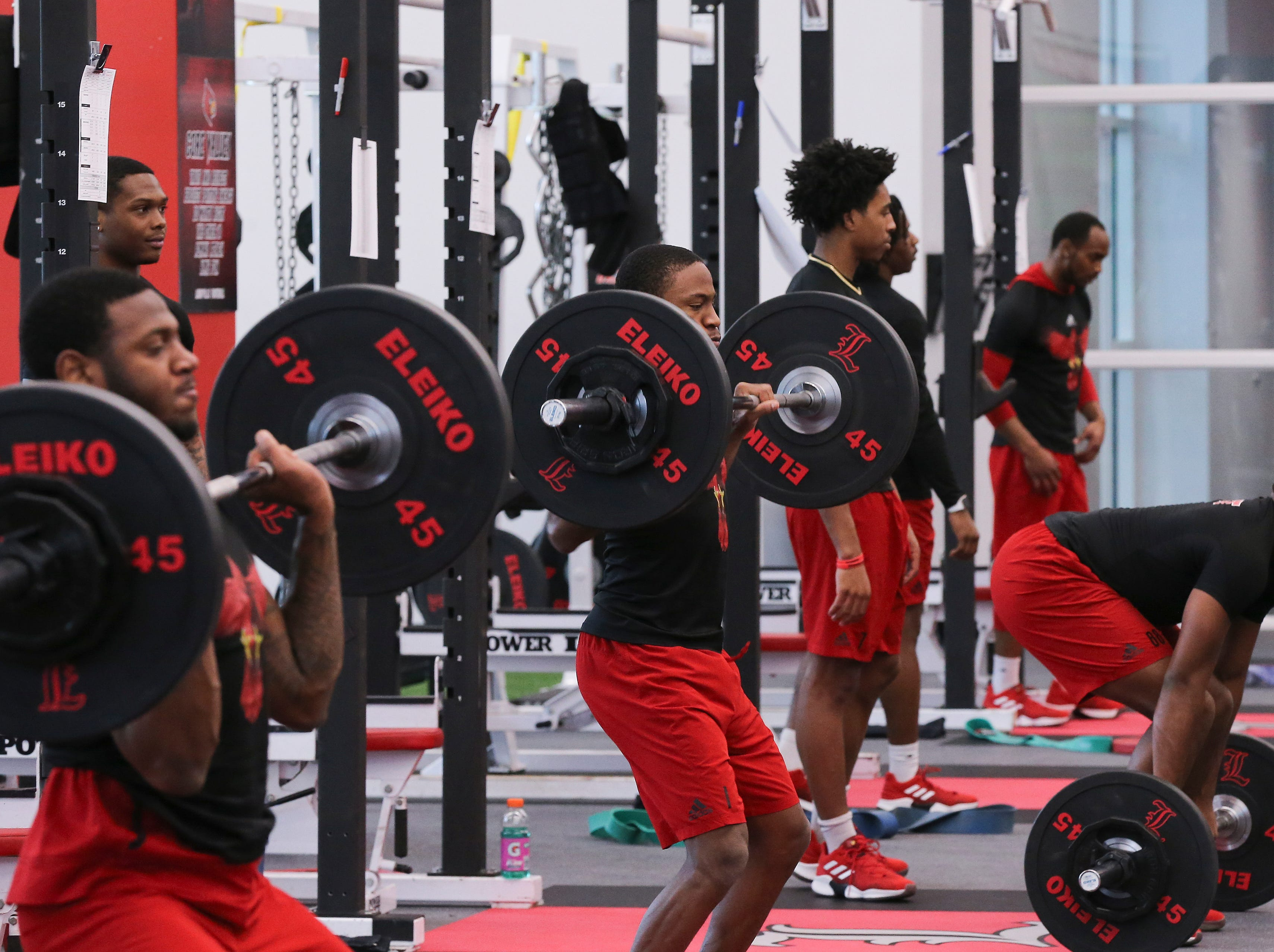 The U of L football team works out during strength and conditioning at the Schnellenberger Complex.