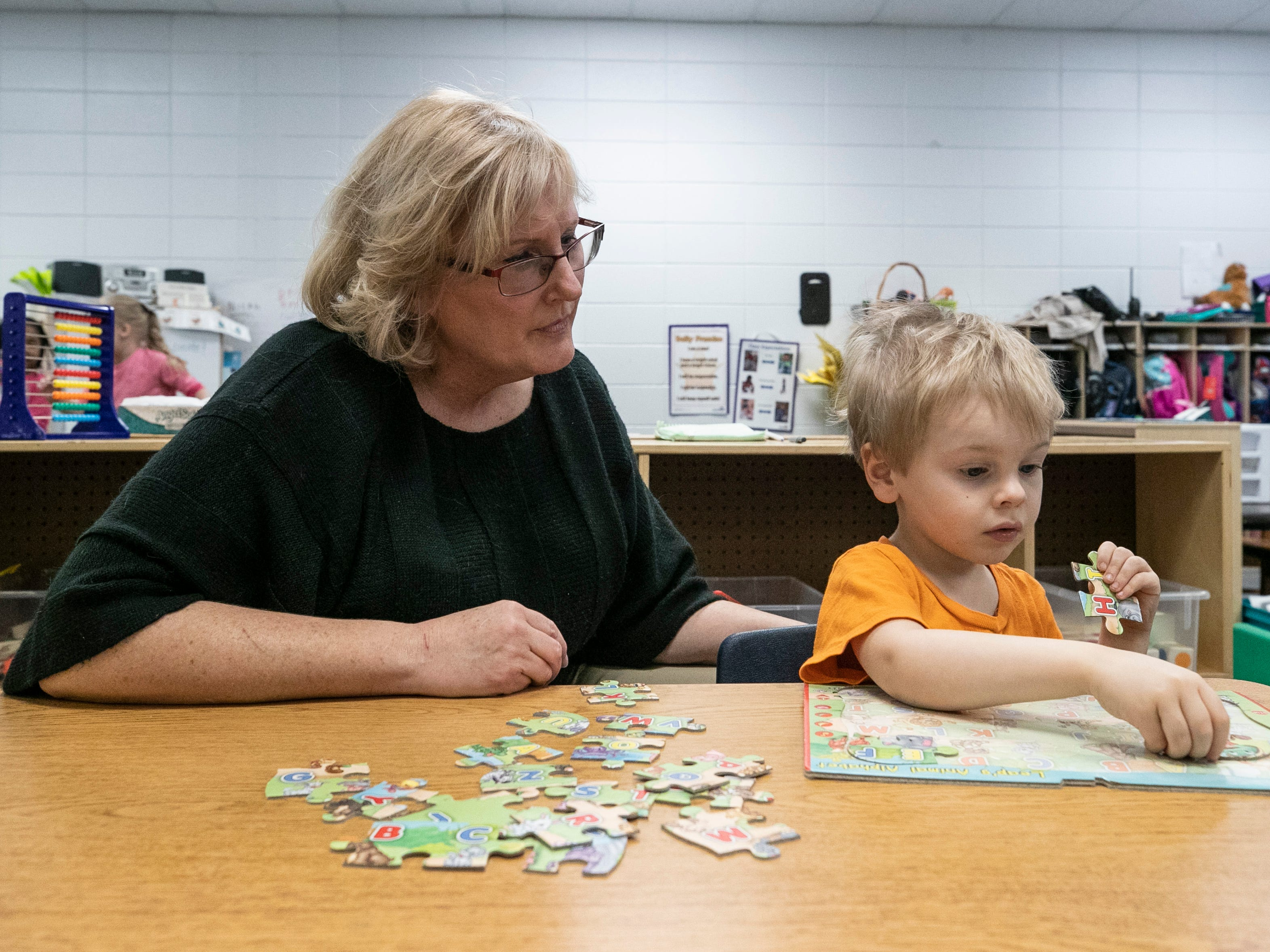 Tabitha Pitman, lead instructional assistant, works with three-year-old Brenden Monk at the Westport Early Childhood Center recently.
