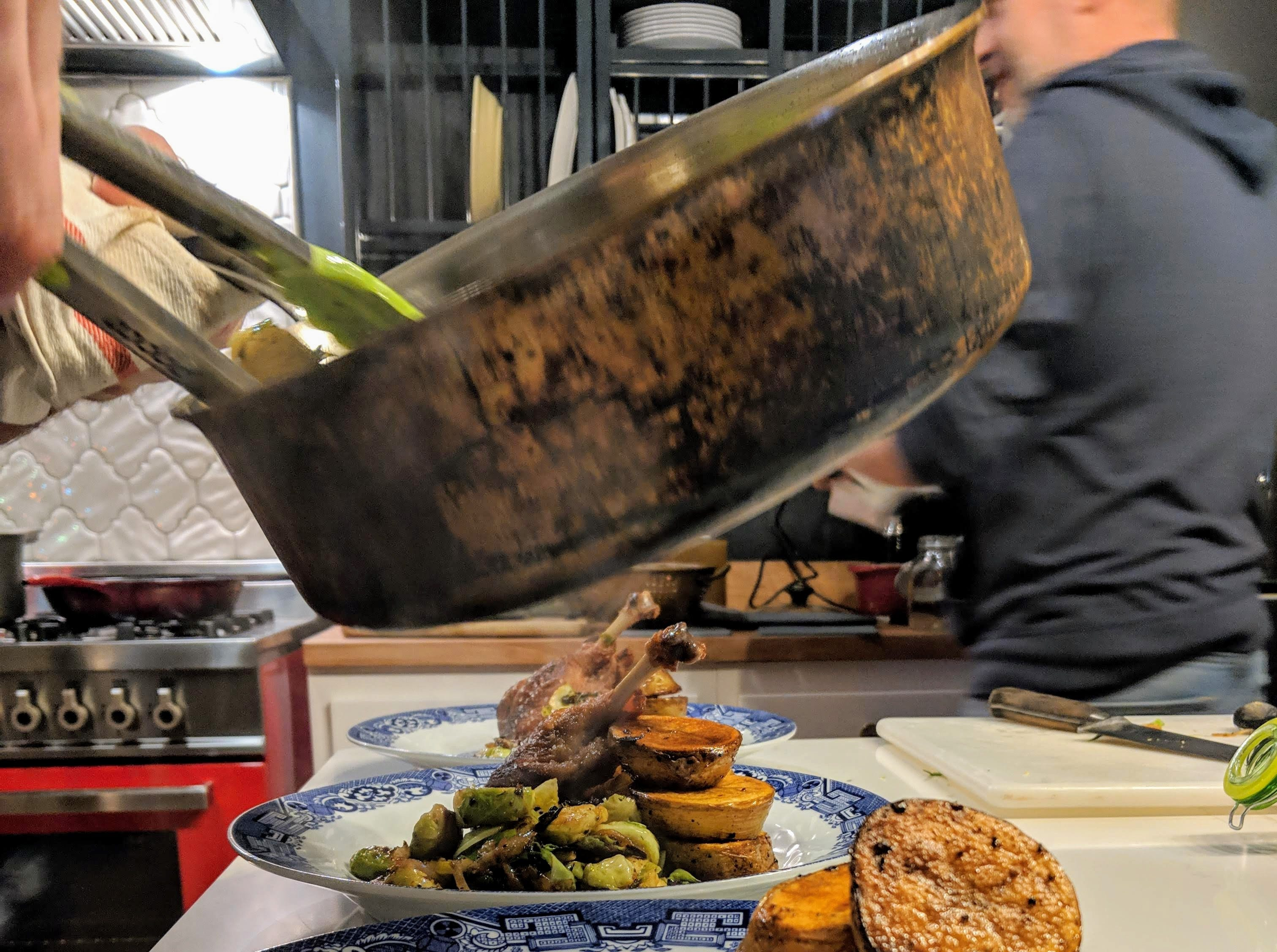 Louisville chef Michael Crouch plates his duck confit and Brussels sprout dish.