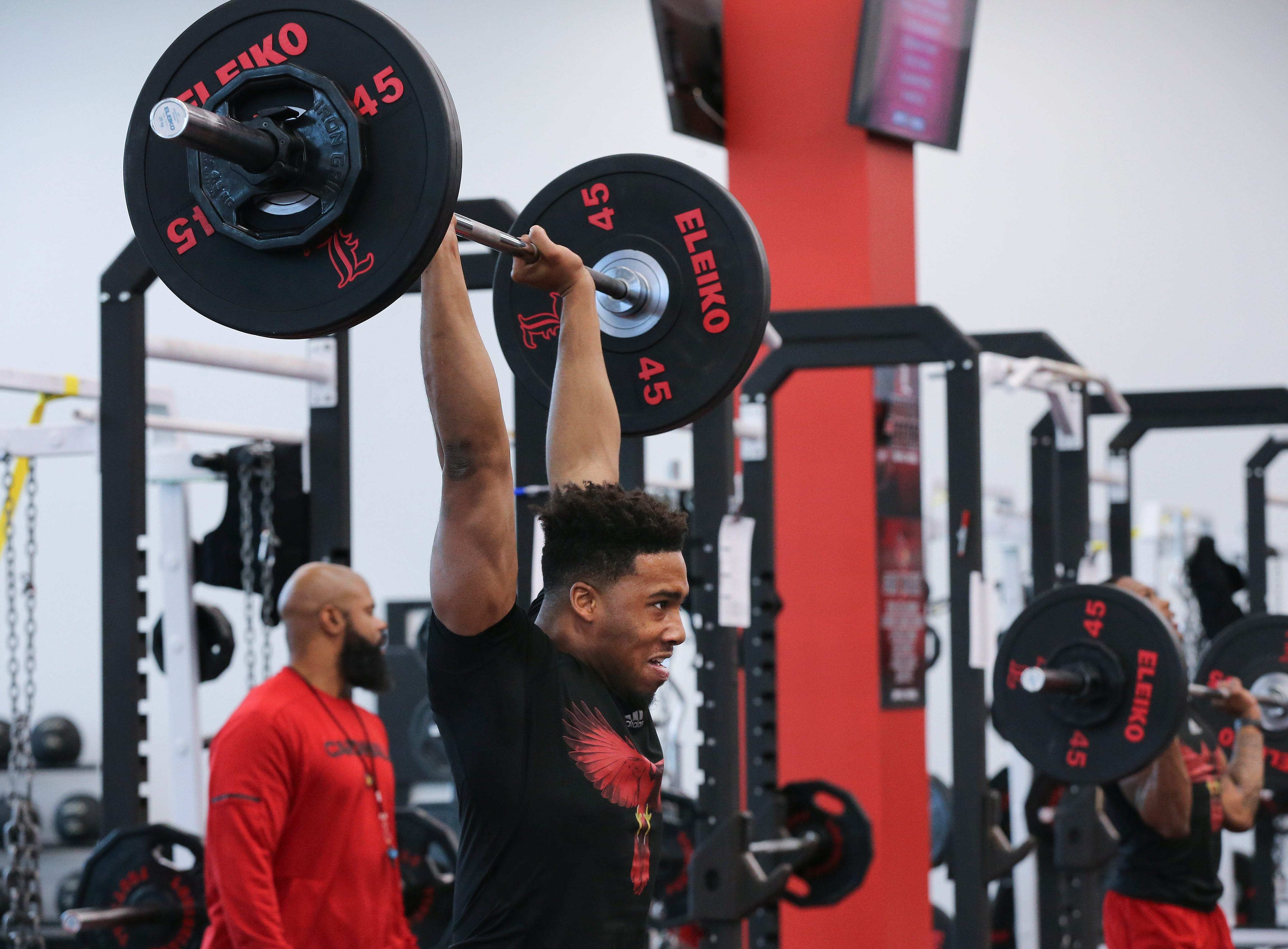 U of L's Quen Head works out during strength and conditioning at the Schnellenberger Complex.