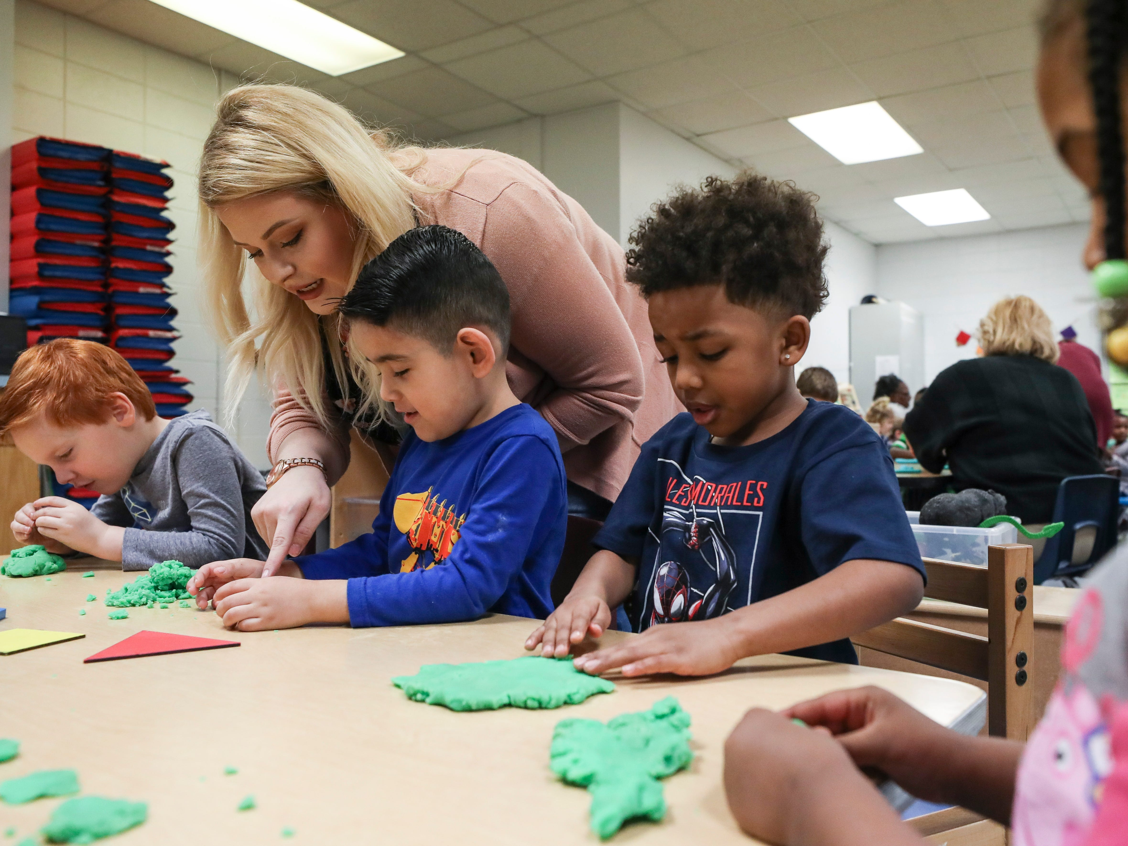 Kayla Hardin, lead teacher, works with some of her pre-kindergarten students at the Westport Early Childhood Center recently.