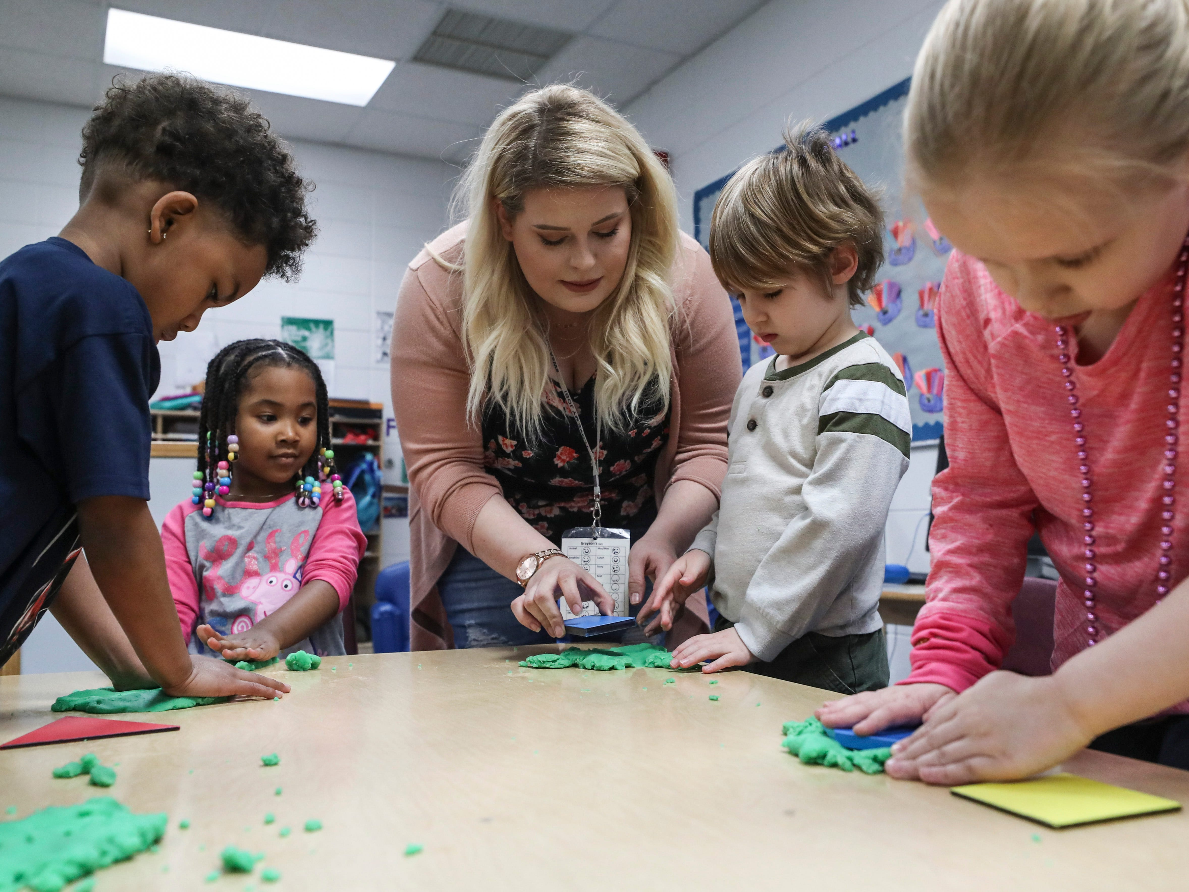 Kayla Hardin, lead teacher, works with some of her prekindergarten students at the Westport Early Childhood Center recently.