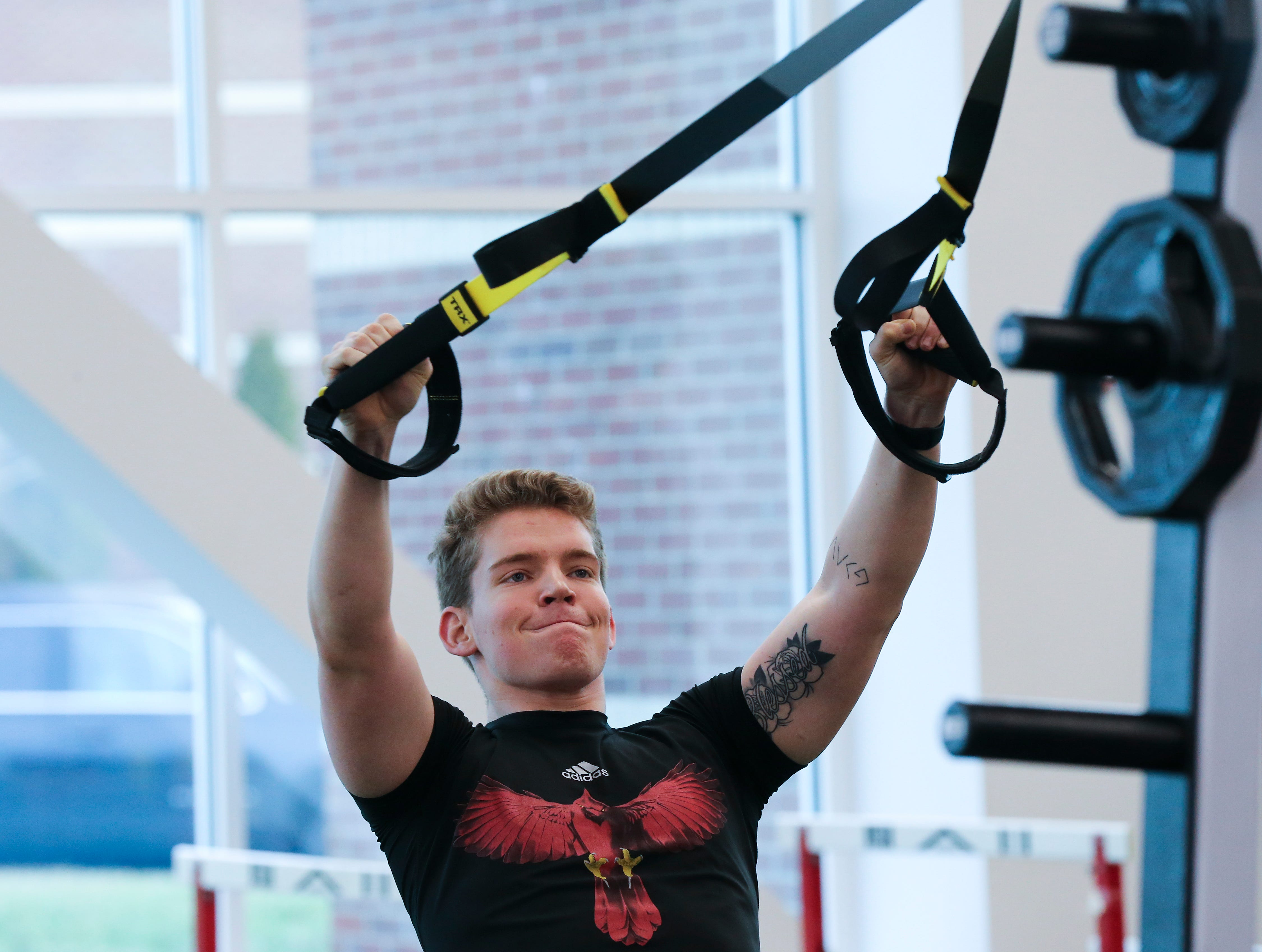 U of L long snapper Mitch Hall works out during strength and conditioning at the Schnellenberger Complex.